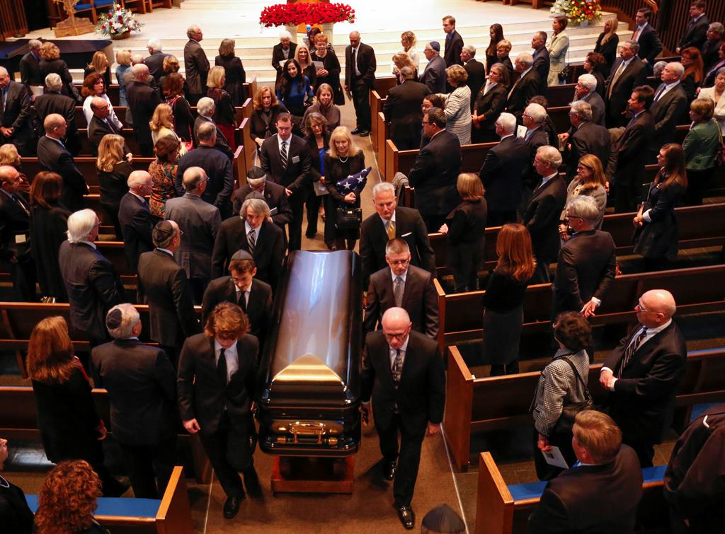 Pall bearers carry the casket of Stanford Lipsey, long-time publisher of The Buffalo News, at the end of funeral services at Temple Beth Zion in Buffalo, Sunday, Nov. 6, 2016.  (Derek Gee/Buffalo News)