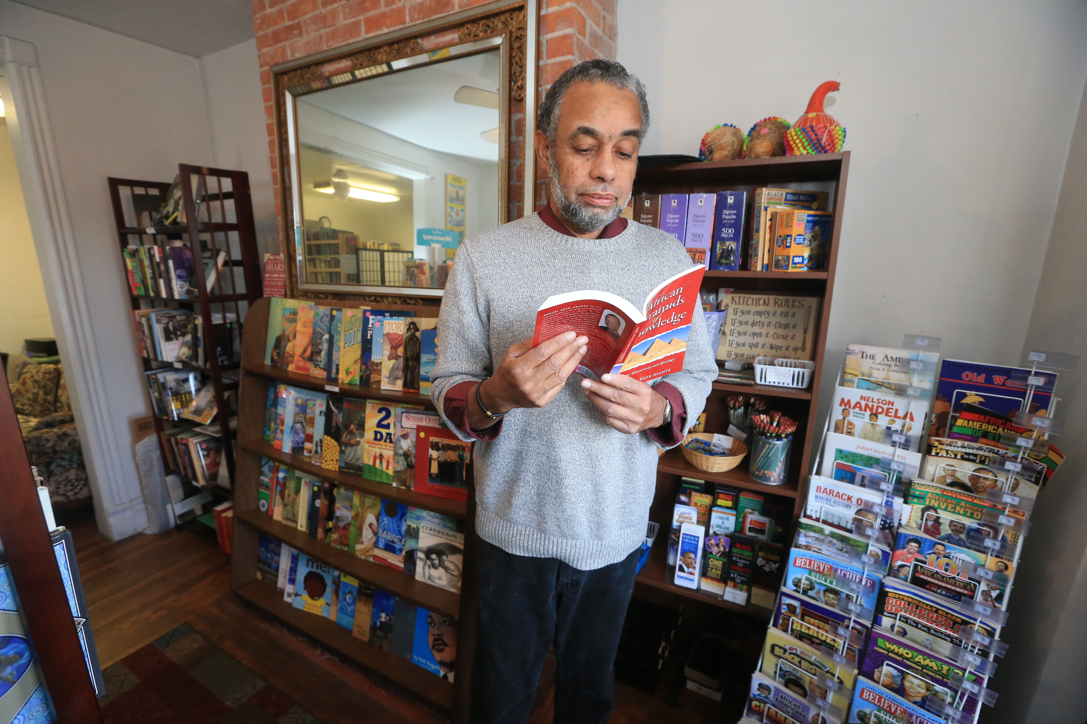 "Ken Holley, who runs Zawadi Books on Jefferson Avenue, says of Buffalo's new African-American history curriculum: ""I'm skeptical if the teachers don't buy into it. You got to ask yourself, 'How are teachers going to teach something they don't know and have never been taught themselves?'"" (John Hickey/Buffalo News)"