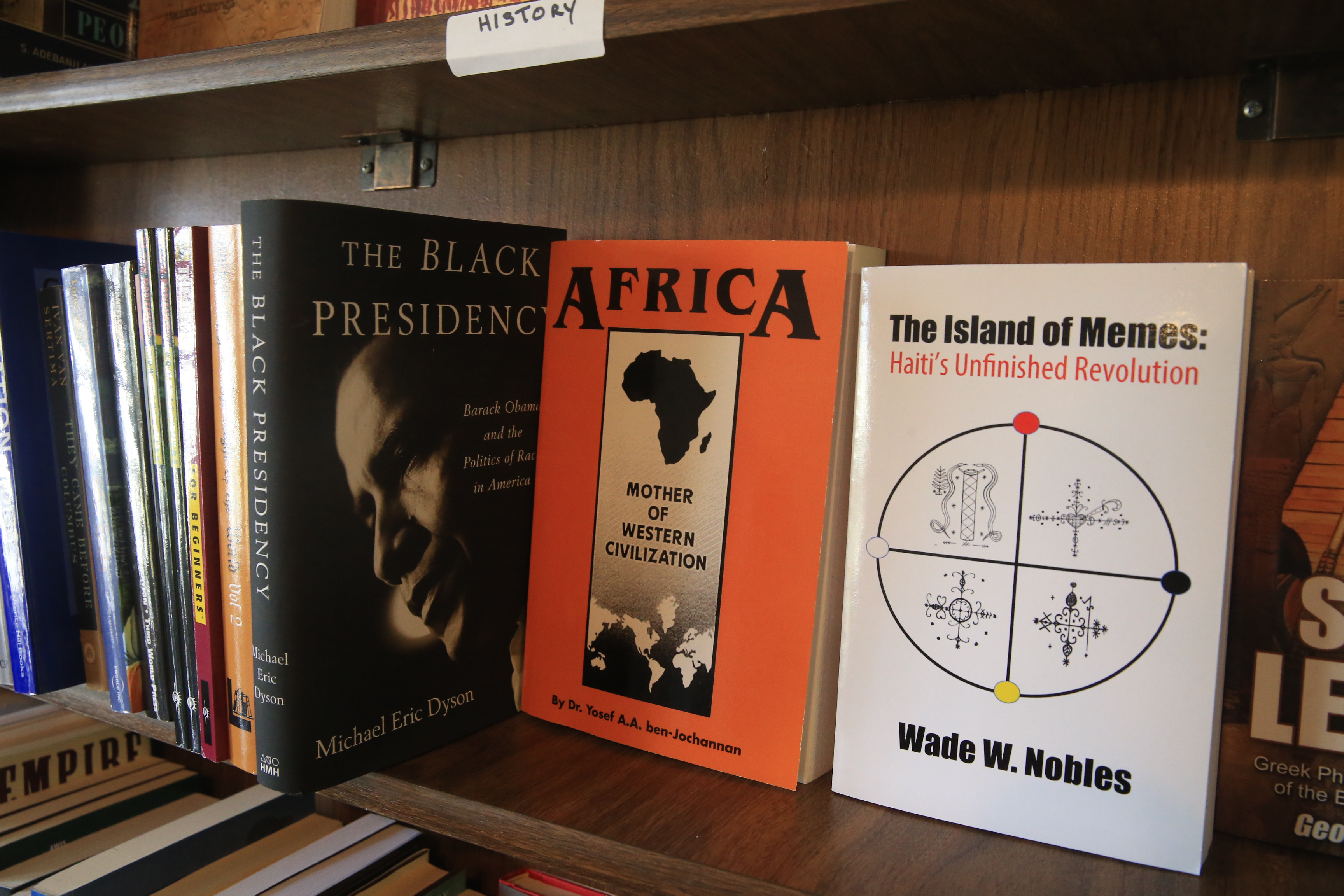 Books on the shelves at Zawadi Books on Jefferson Avenue which helps customers looking for resources to educate themselves and their kids on African-American history. (John Hickey/Buffalo News)