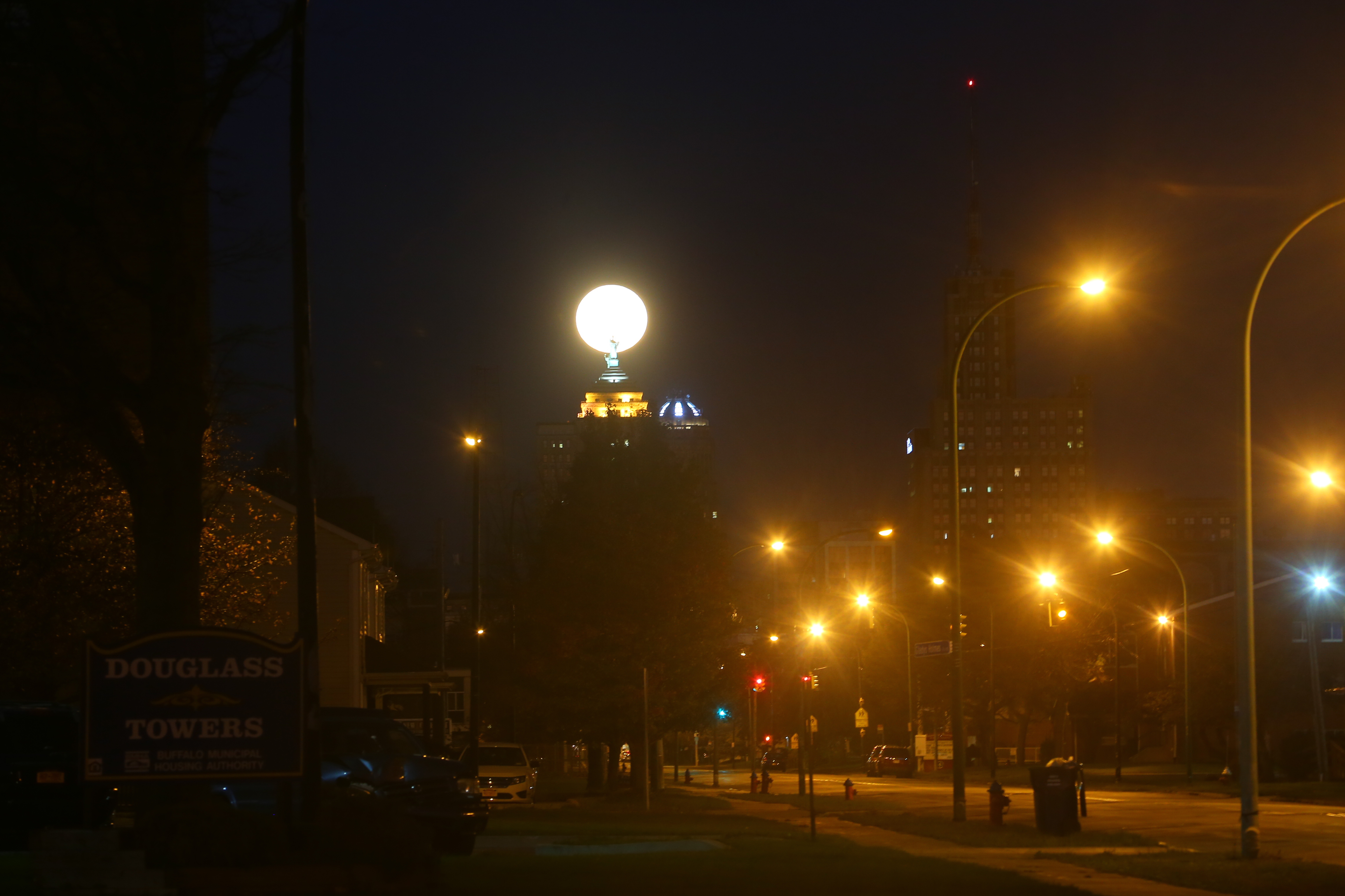 The supermoon sets over the Liberty Building in the early morning on Nov. 14 in Buffalo. (John Hickey/Buffalo News)