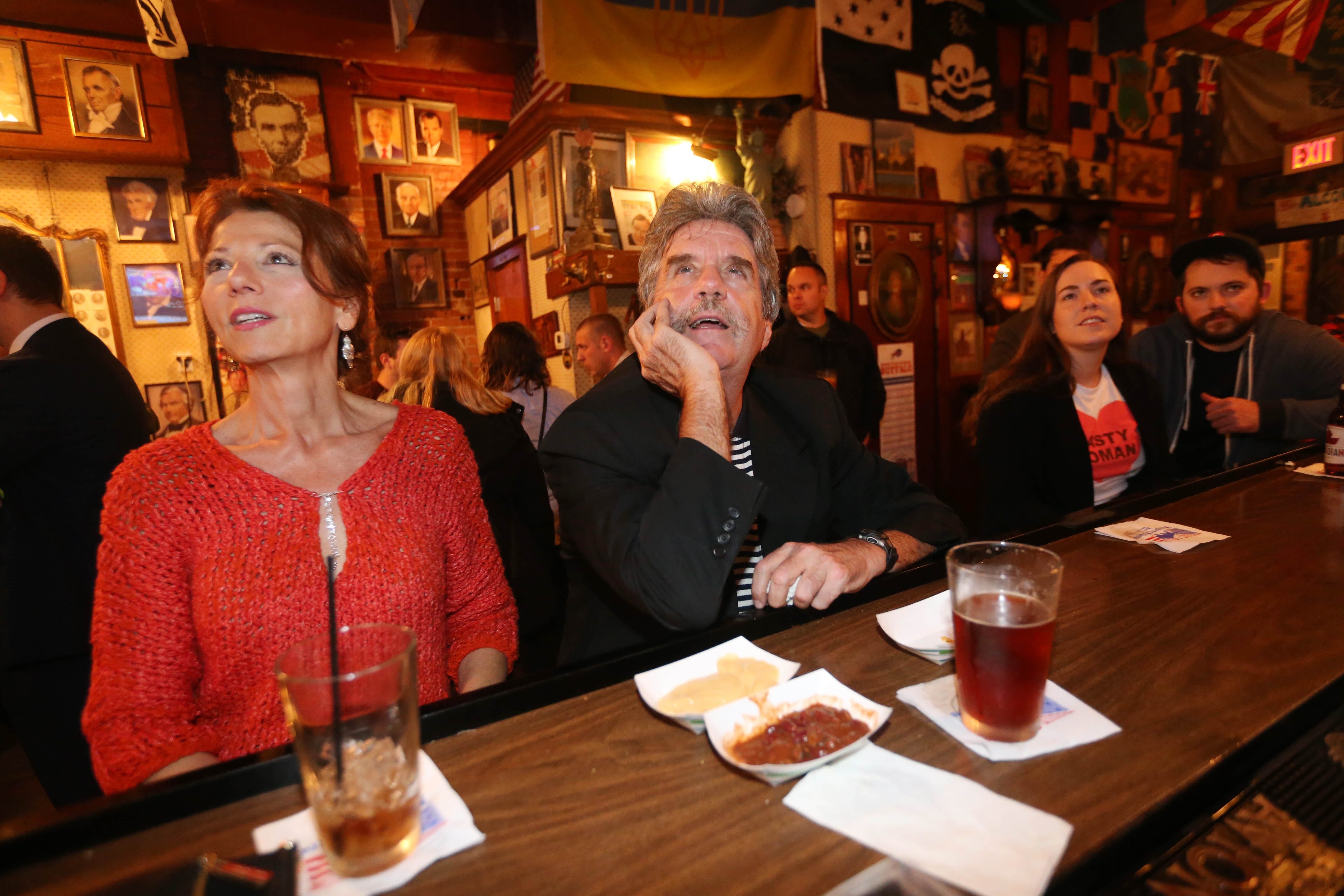 Maria Glover, of Kenmore, and Patrick Ellis of Orchard Park settle in for the night at Founding Fathers Pub in Buffalo to watch election results, Tuesday, Nov. 8, 2016. (Sharon Cantillon/Buffalo News)