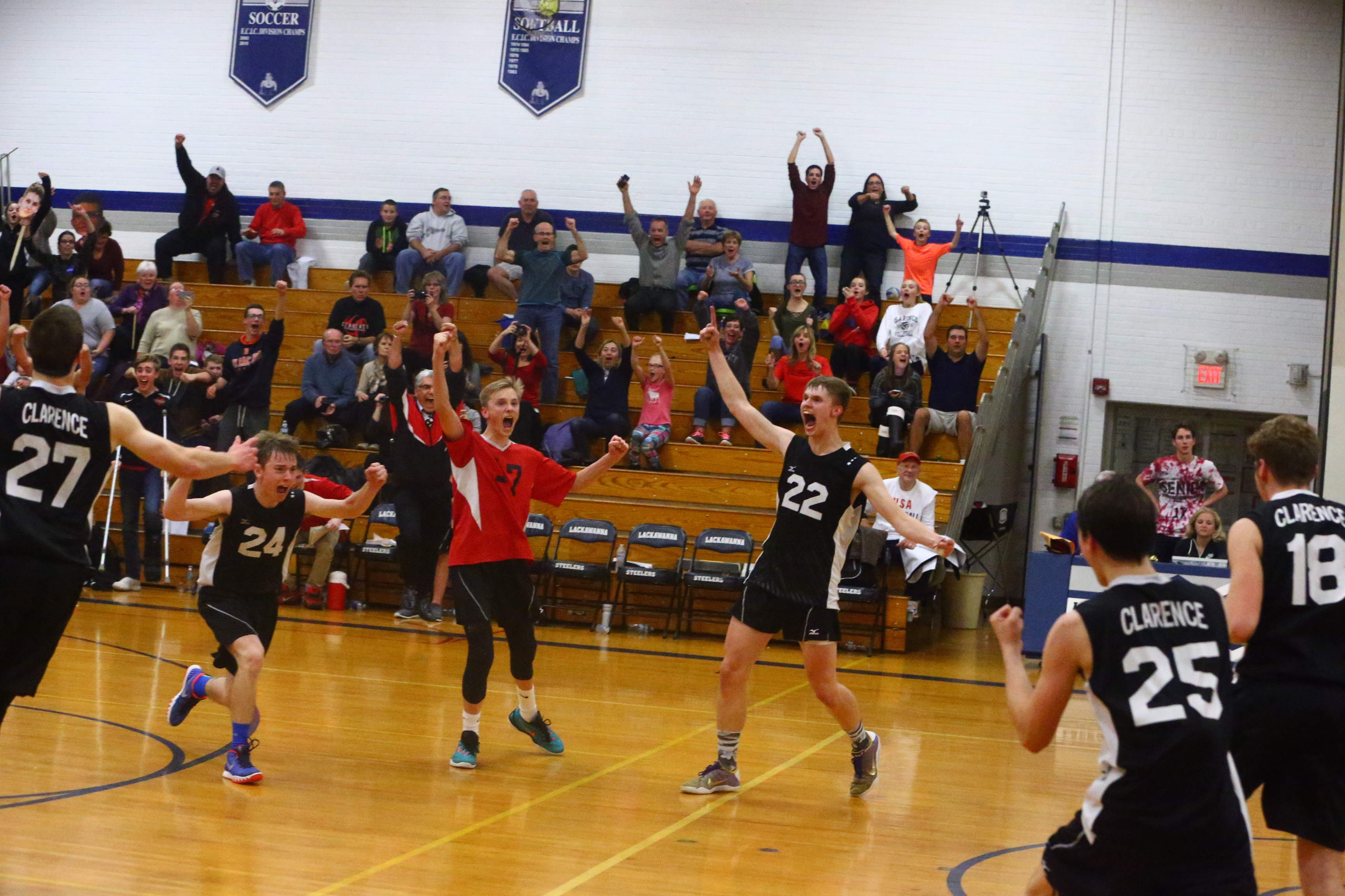 Clarence celebrates its win over Lockport in the Section VI Division I boys volleyball championships at  Lackawanna. (John Hickey/Buffalo News)