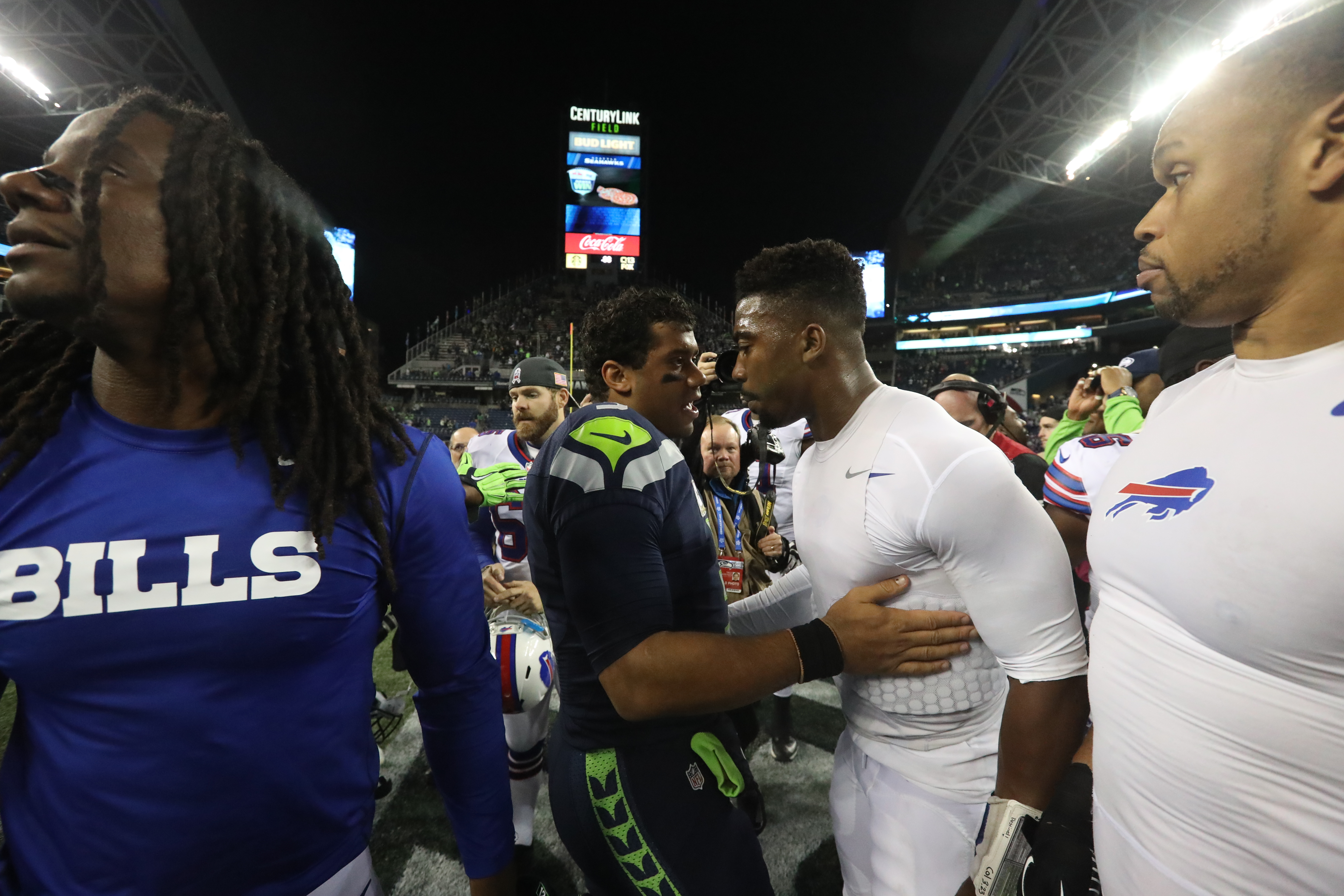 Buffalo Bills quarterback Tyrod Taylor (5) and Seattle Seahawks quarterback Russell Wilson (3) shake hands at the end of the game. (James P. McCoy/Buffalo News)
