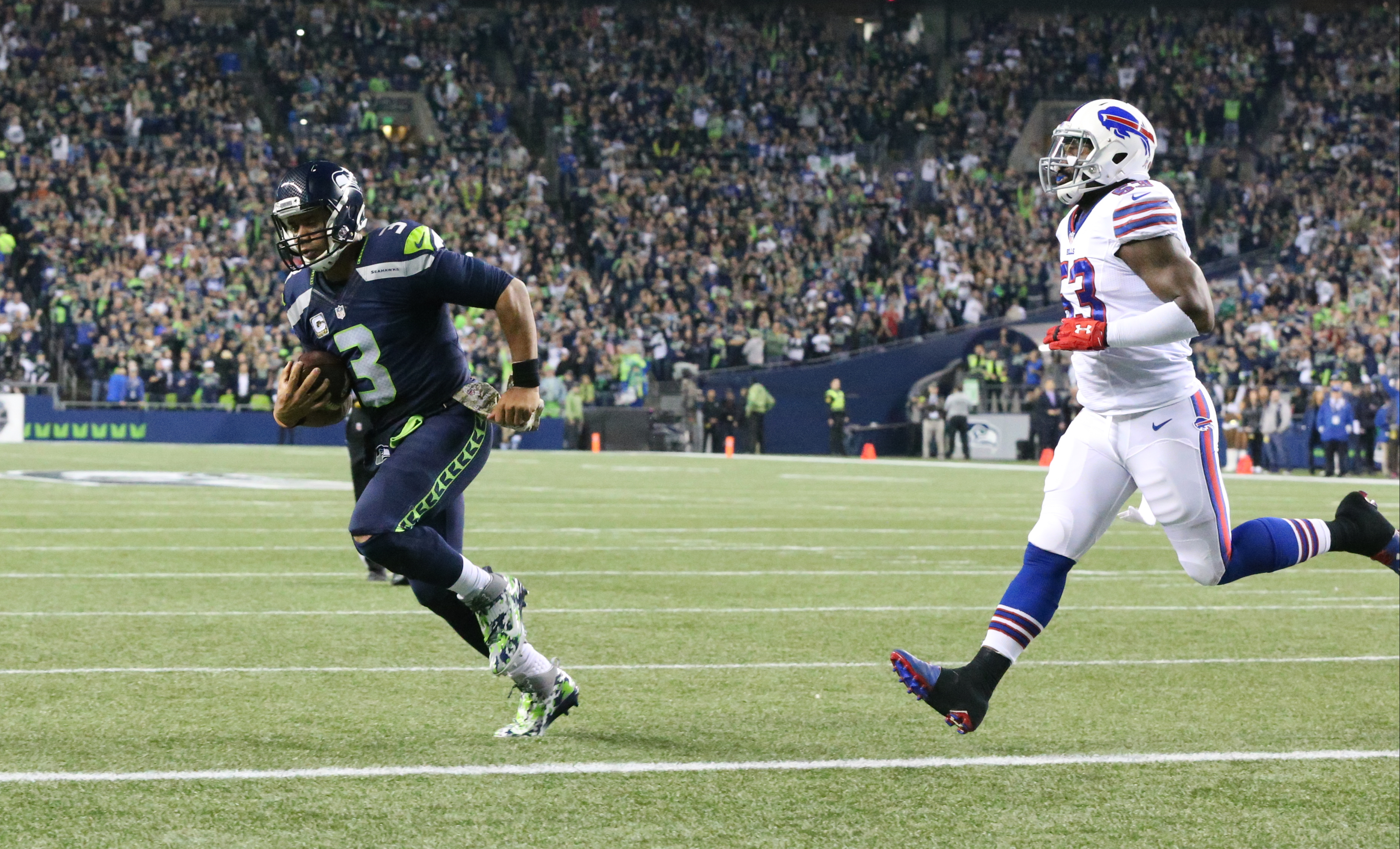 Seattle Seahawks quarterback Russell Wilson (3) runs for a touchdown as he is chased by Buffalo Bills inside linebacker Preston Brown (52) in the first quarter of a game at CenturyLink Field in Seattle on Monday, Nov.  7, 2016.  (James P. McCoy/Buffalo News)