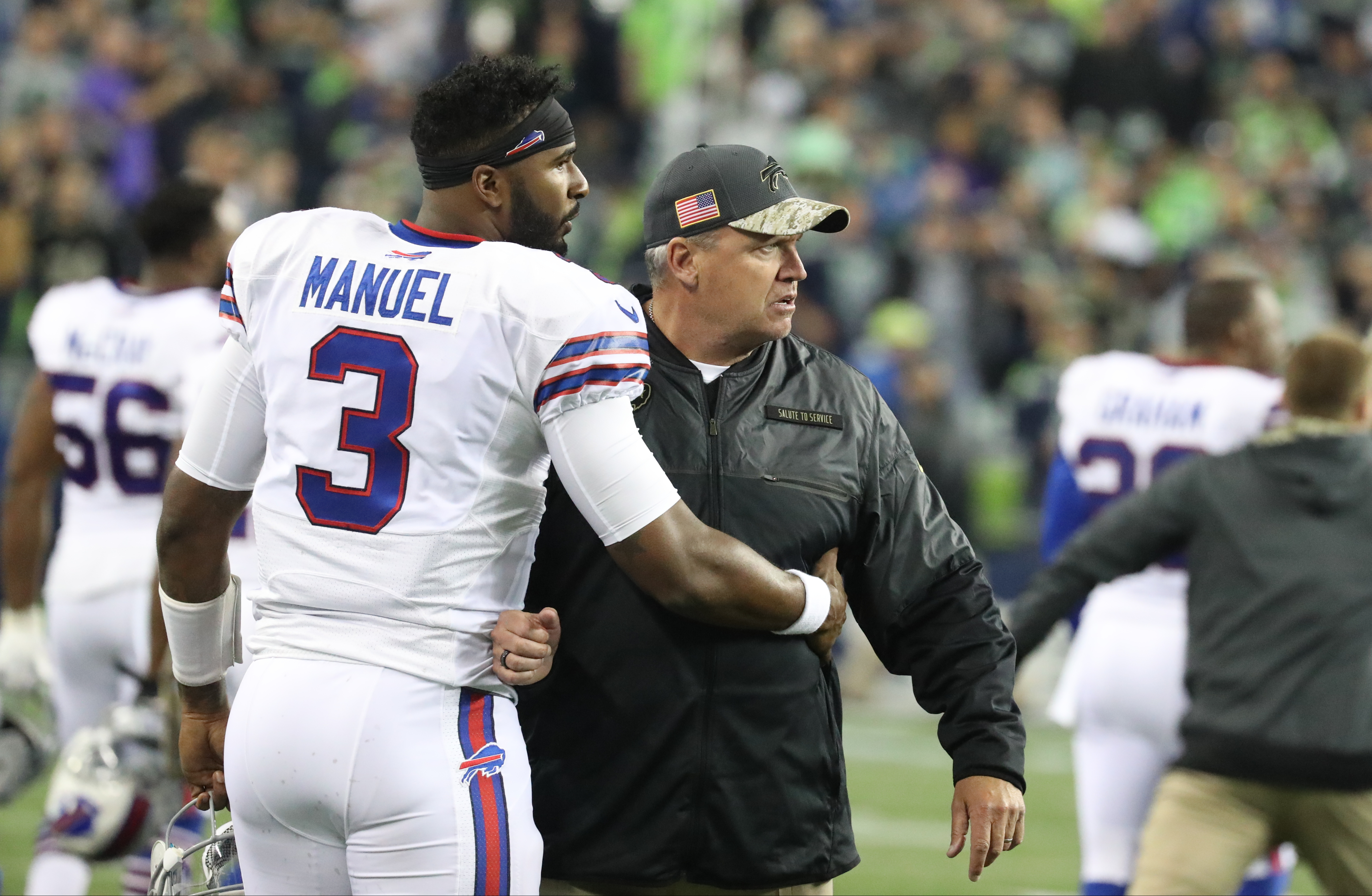 Buffalo Bills quarterback EJ Manuel (3) holds back Buffalo Bills head coach Rex Ryan at the end of the first half of a game against the Seattle Seahawks at CenturyLink Field in Seattle on Monday, Nov.  7, 2016.  (James P. McCoy/Buffalo News)