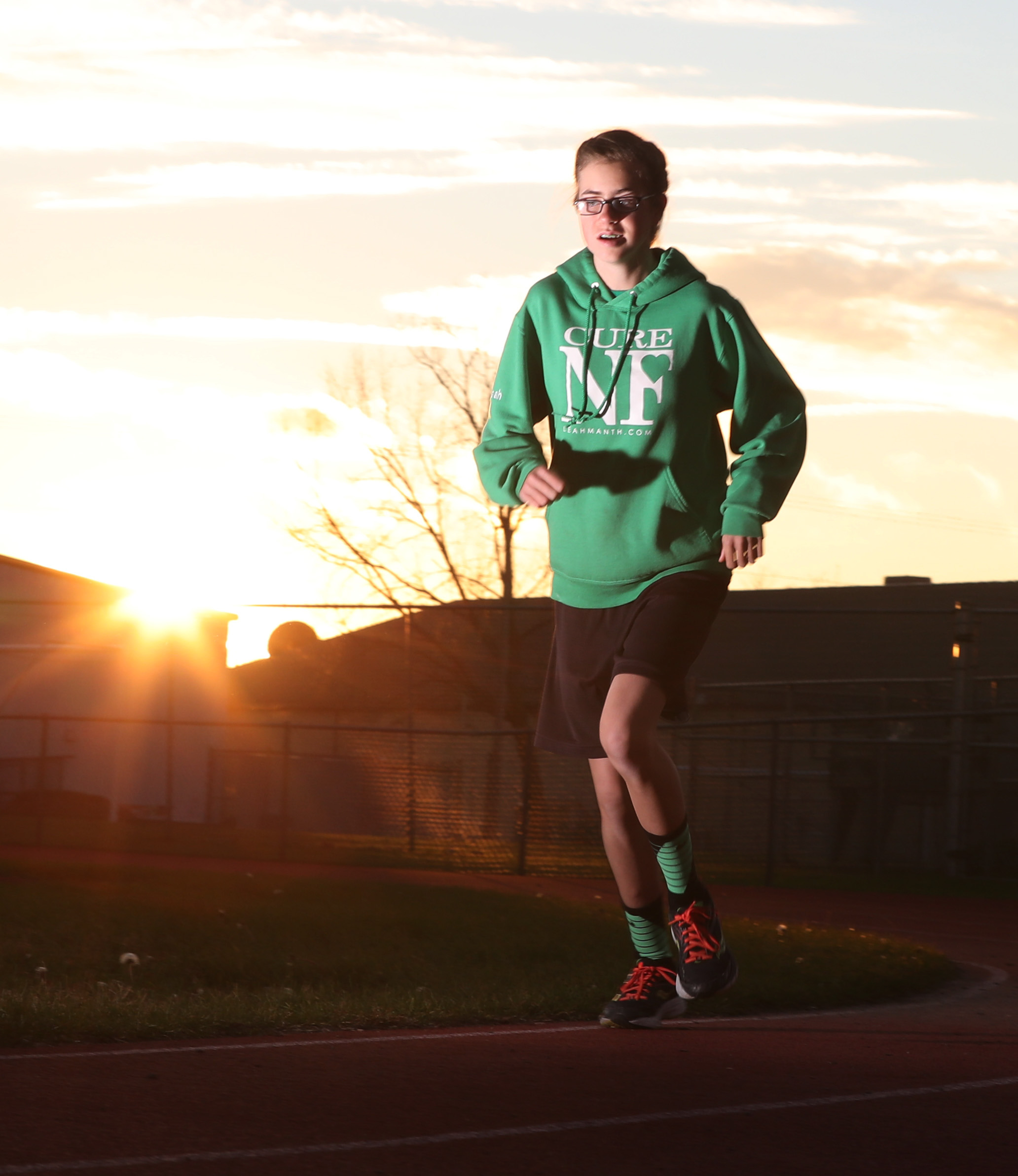 Leah Manth is a cross country/track runner with Neurofibromitosis Type 2. There is no cure for her condition. (James P. McCoy/Buffalo News)