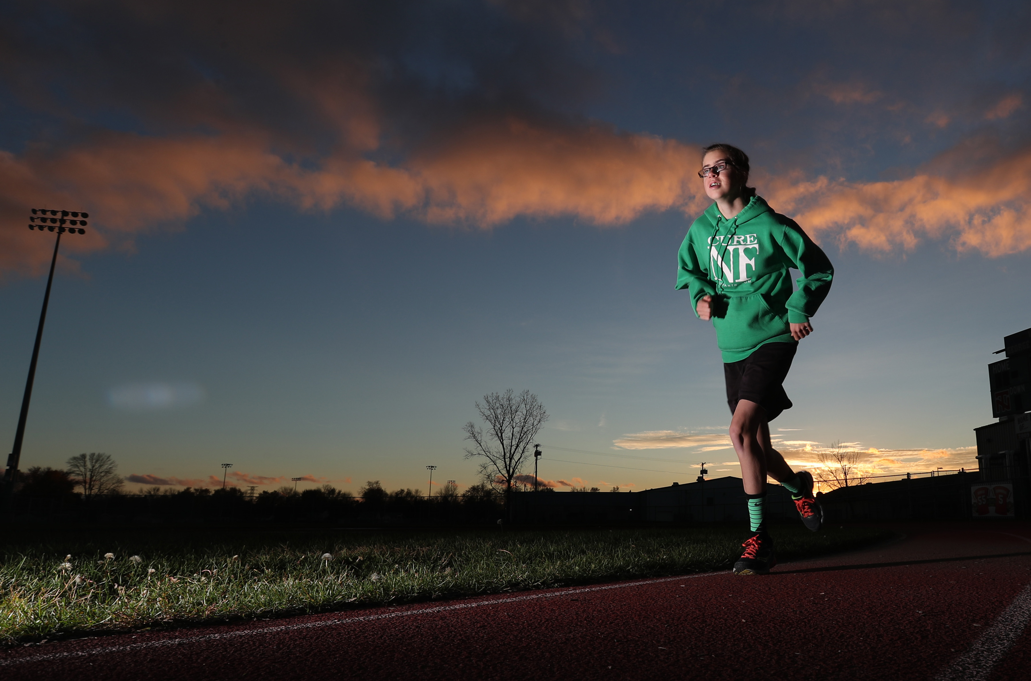 Leah Manth is a cross country/track runner with Type 2 neurofibromitosis. There is no cure for her condition. (James P. McCoy/Buffalo News)