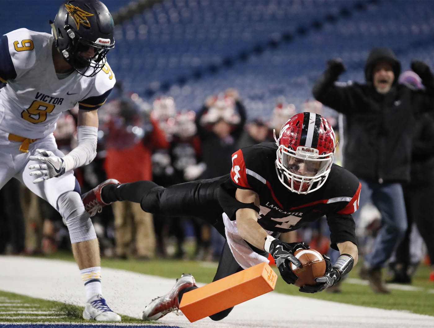 Lancaster receiver Max Giordano catches a touchdown pass against Victor during second half action of the Class C Far West Regional at New Era Field on Saturday, Nov. 12, 2016.(Harry Scull Jr./Buffalo News)