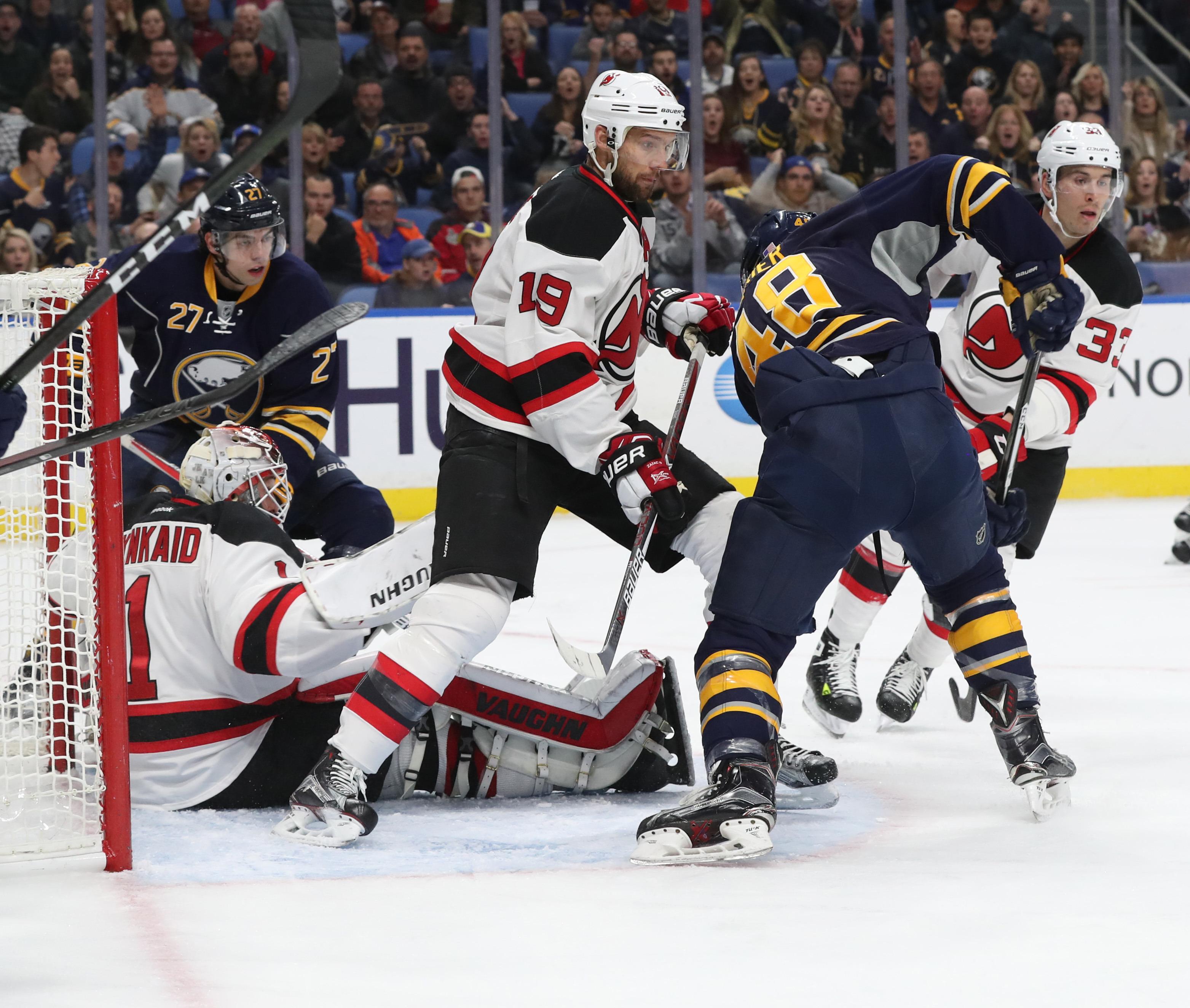William Carrier (48) battles New Jersey Devils goalie Keith Kinkaid.  (James P. McCoy/Buffalo News)