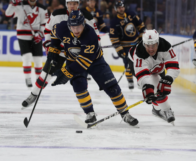 Sabres center Johan Larsson (22) battles New Jersey winger PA Parenteau (11). (James P. McCoy/Buffalo News)