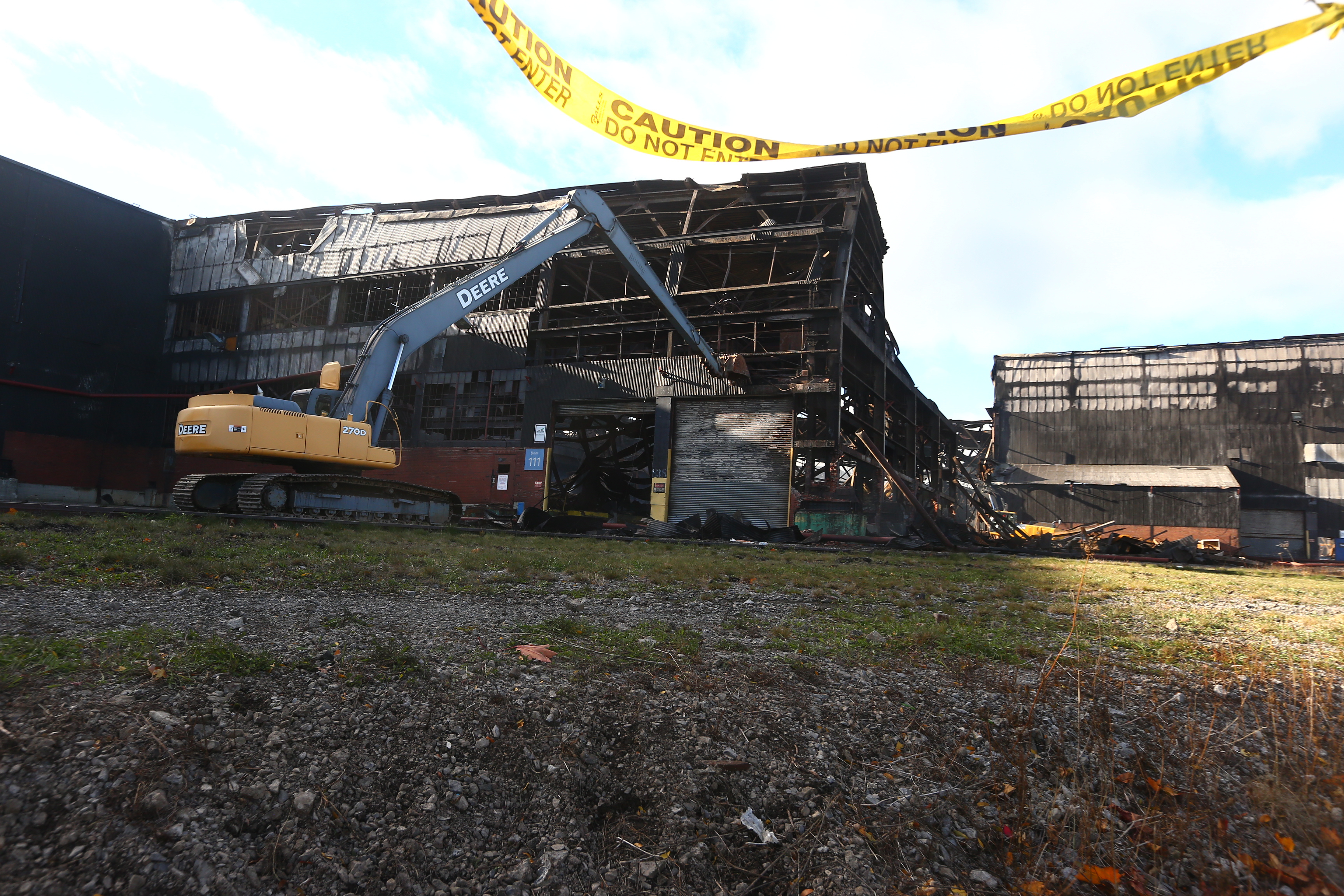 Crews work to demolish the former Bethlehem Steel building on Route 5 after a fire ripped through the building on Friday, Nov. 11, 2016. (John Hickey/Buffalo News)