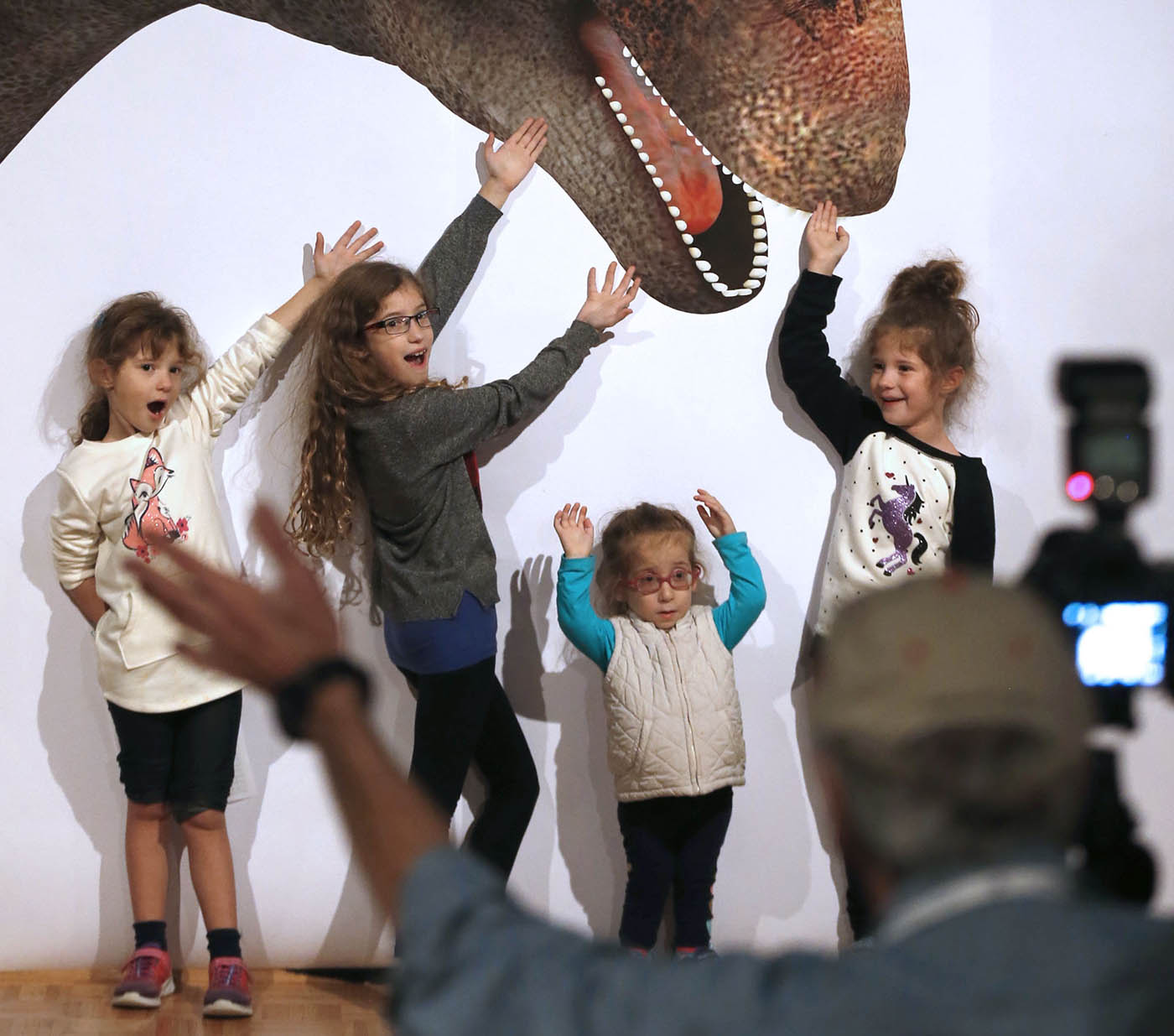"The museum's camera club volunteered their services photographing families near a giant dino poster during ""Dino Daze"" at the Buffalo Museum of Science onSaturday, Nov. 12, 2016. The Gabel Family of North Tonawanda from left, Grace, 6, Macy, 8, Piper, 4, and Ashlyn, 6. Photographer's name is Ted Lesinski. (Robert Kirkham/Buffalo News)"