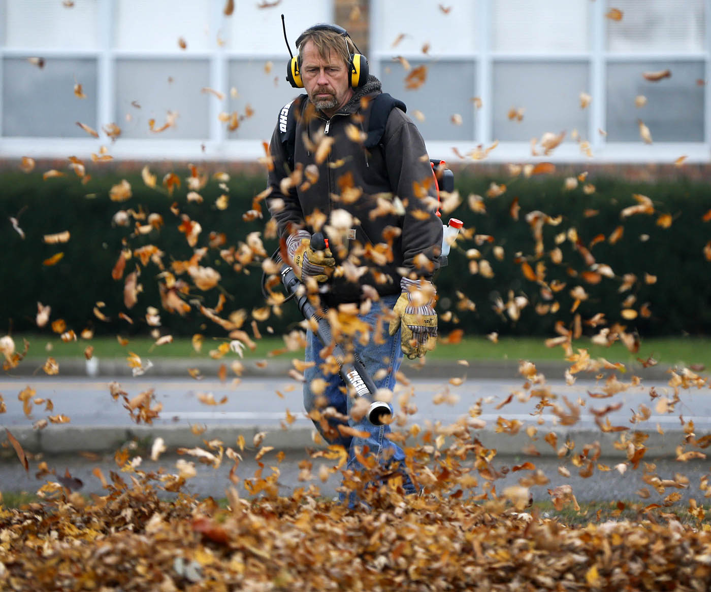 Eric Matwijow blows leaves into a pile on Abbott Rd in Orchard Park Wednesday, Nov. 16, 2016. (Mark Mulville/Buffalo News)