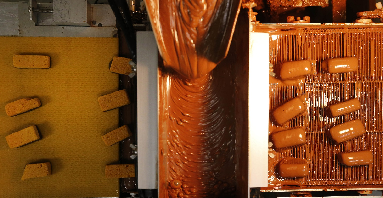 Sponge candy gets its chocolate covering at Ko-Ed Candies. (Mark Mulville/Buffalo News)