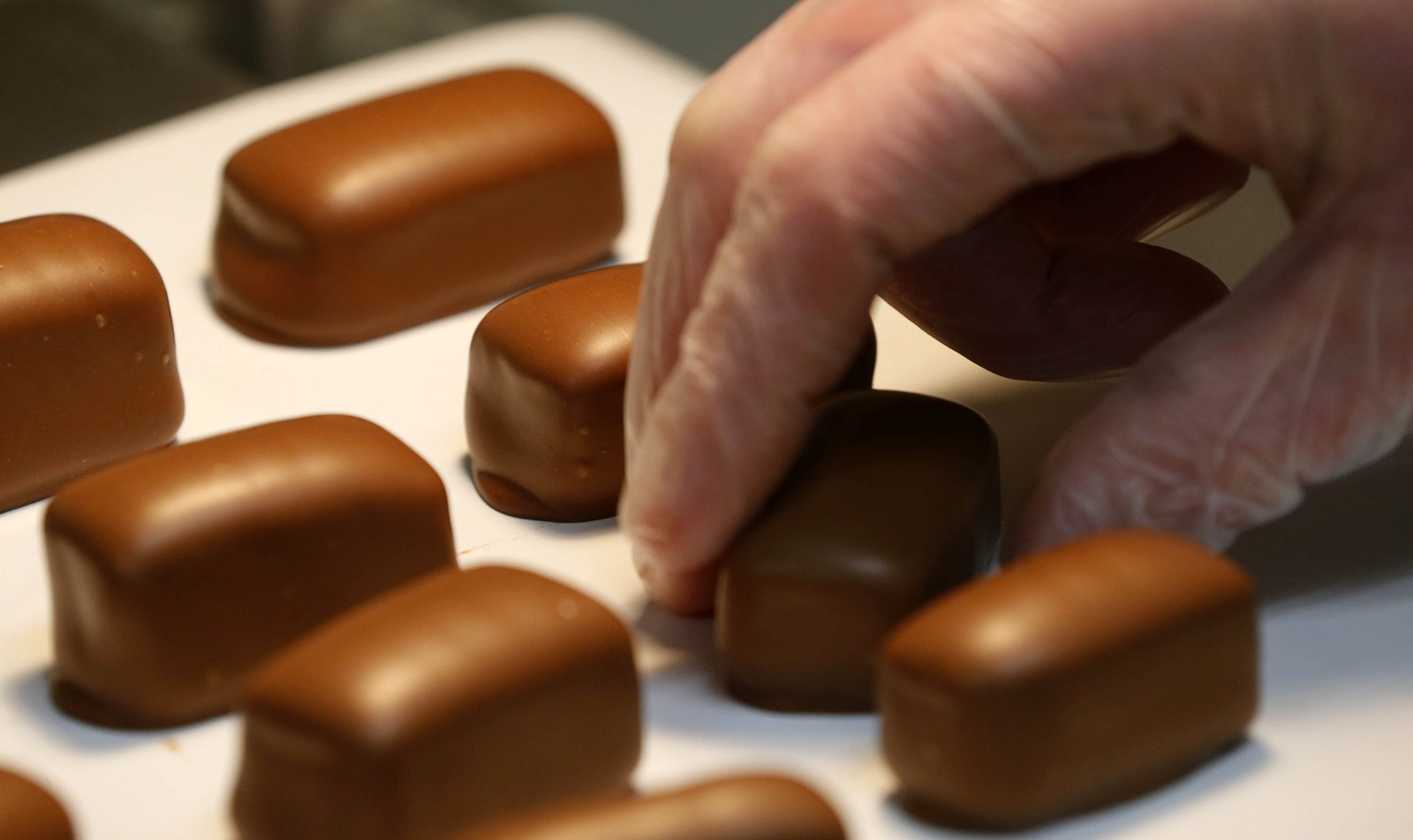 David Moteyunas sorts the finished sponge candy at Ko-Ed Candies in South Buffalo. (Mark Mulville/Buffalo News)