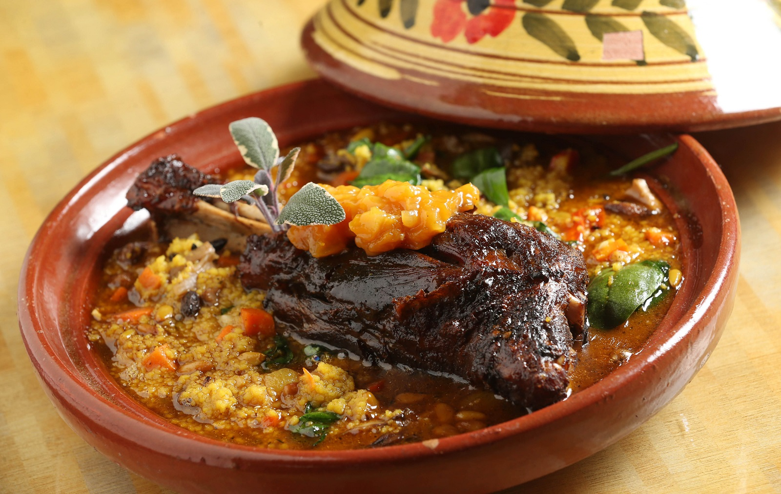 Fiero's lamb tangine is roasted lamb shank served on Israeli couscous with roasted seasonal vegetables topped with apricot chutney. (Sharon Cantillon/Buffalo News)