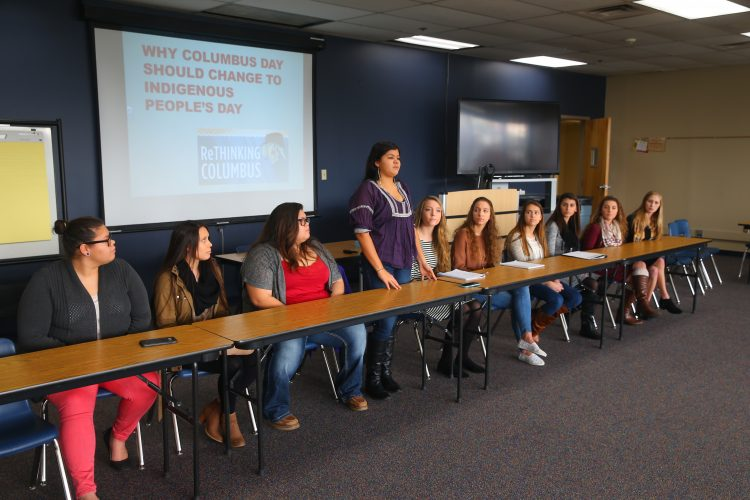 Ouinna Hamby,(Standing)  vice president of the Native American Club, and other students from Niagara Wheatfield High School's Native American Club and Student Council  presented a Power Point on why Columbus Day should be changed to Indigenous Peoples Day before the Native American Regional Forum. (John Hickey/Buffalo News)