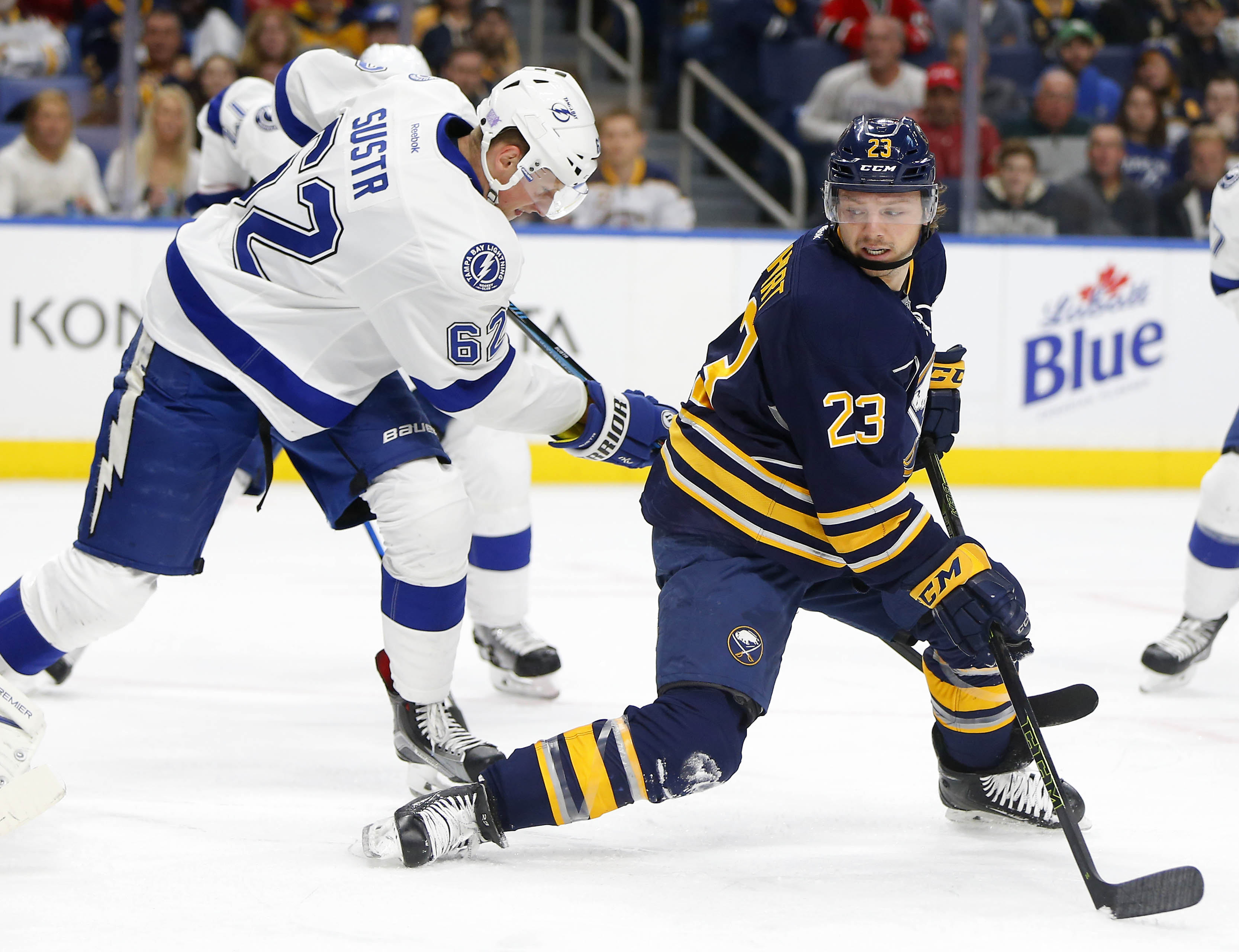 Sam Reinhart looks for a rebound in front as he is defended by Andrej Sustr. (Mark Mulville/Buffalo News)