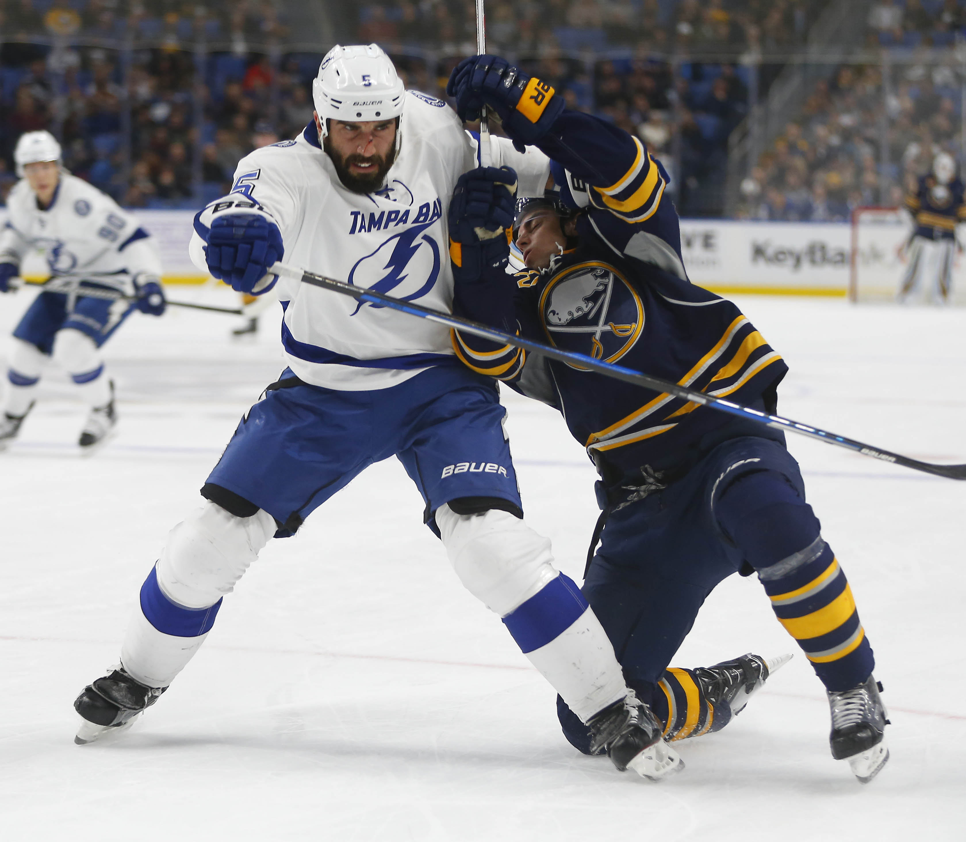 Derek Grant tries to get past Tampa Bay's Jason Garrison in the first period. (Mark Mulville/Buffalo News)