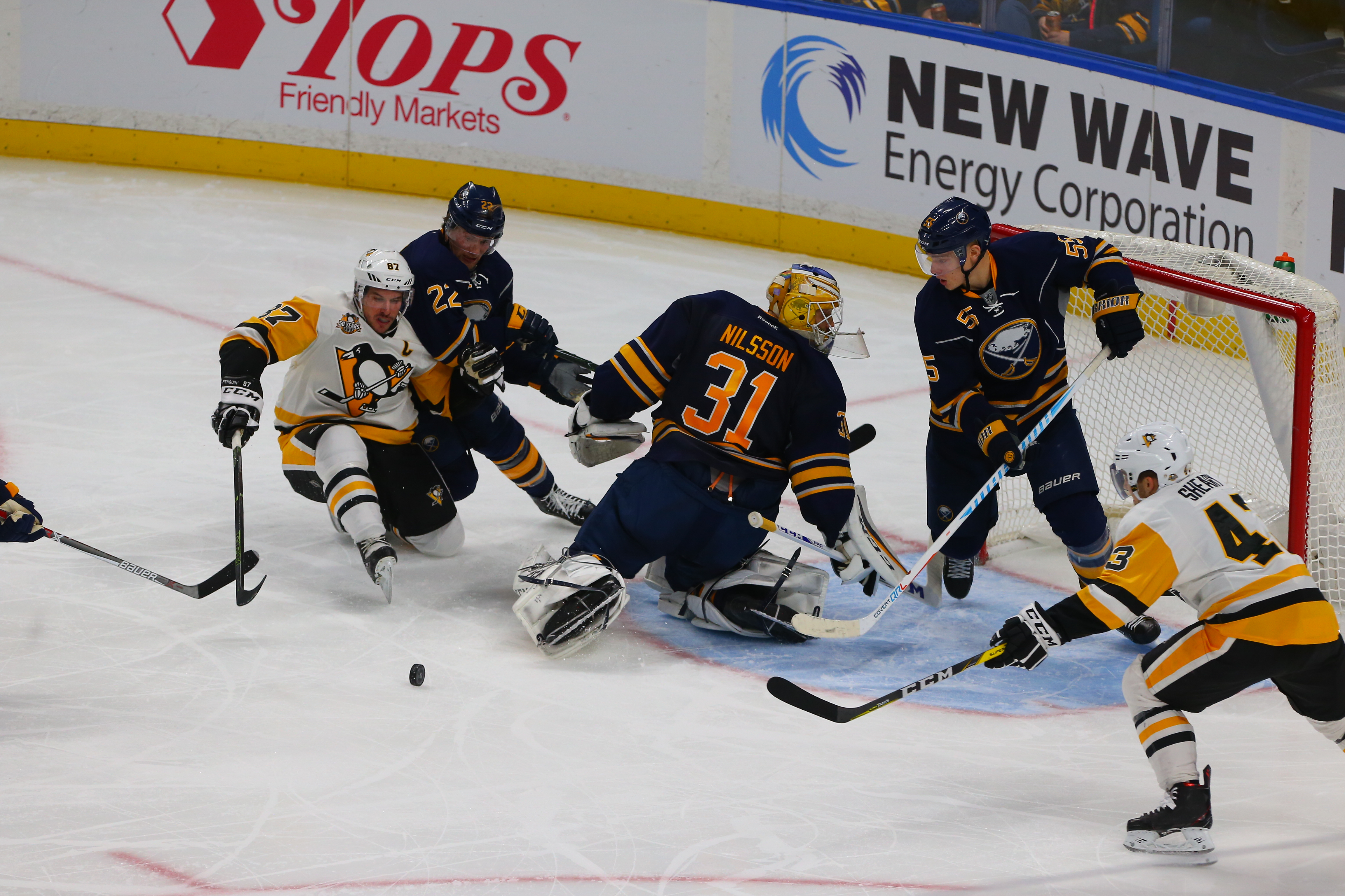 Goalie Anders Nilsson (31), Johan Larsson (22) and Rasmus Ristolainen battle Sidney Crosby for the puck in the seocnd period. (John Hickey/Buffalo News).