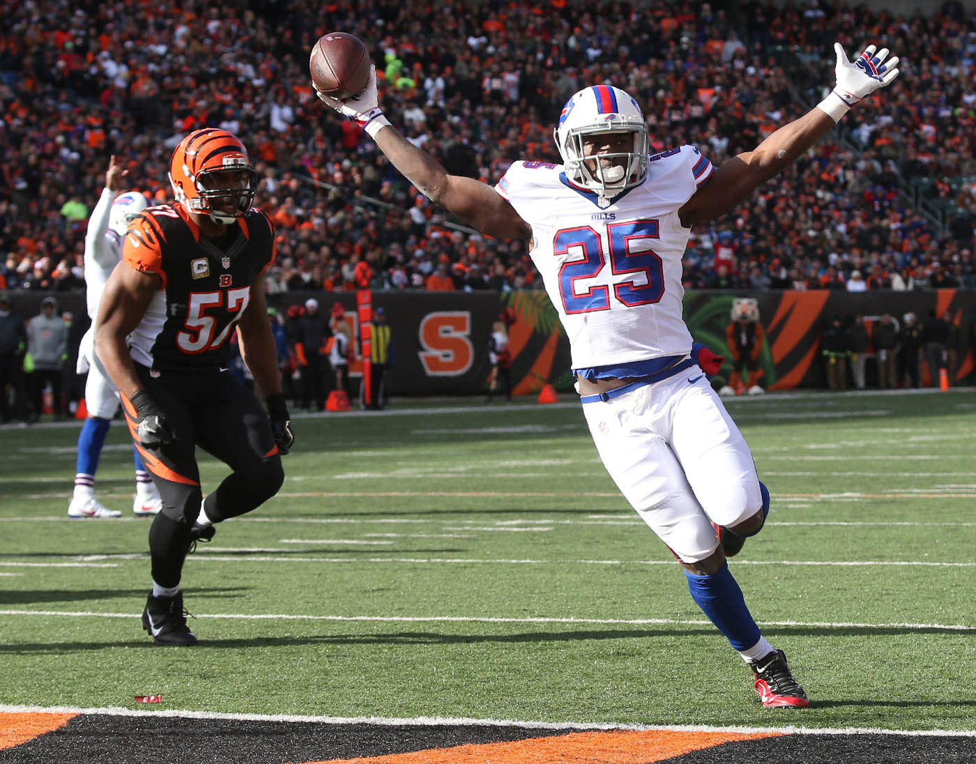 Buffalo Bills running back LeSean McCoy (25) rushes for a touchdown agaist Cincinnati Bengals outside linebacker Vincent Rey (57) in the first quarter at Paul Brown Stadium in Cincinnati Ohio on Sunday, Nov. 20, 2016.  (James P. McCoy/Buffalo News)