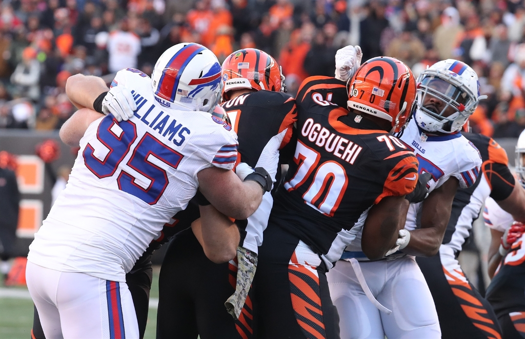 Buffalo Bills defensive end Kyle Williams (95) pressures Cincinnati Bengals quarterback Andy Dalton (14) during the third quarter at Paul Brown Stadium in Cincinnati Ohio on Sunday, Nov. 20, 2016. (James P. McCoy/Buffalo News)