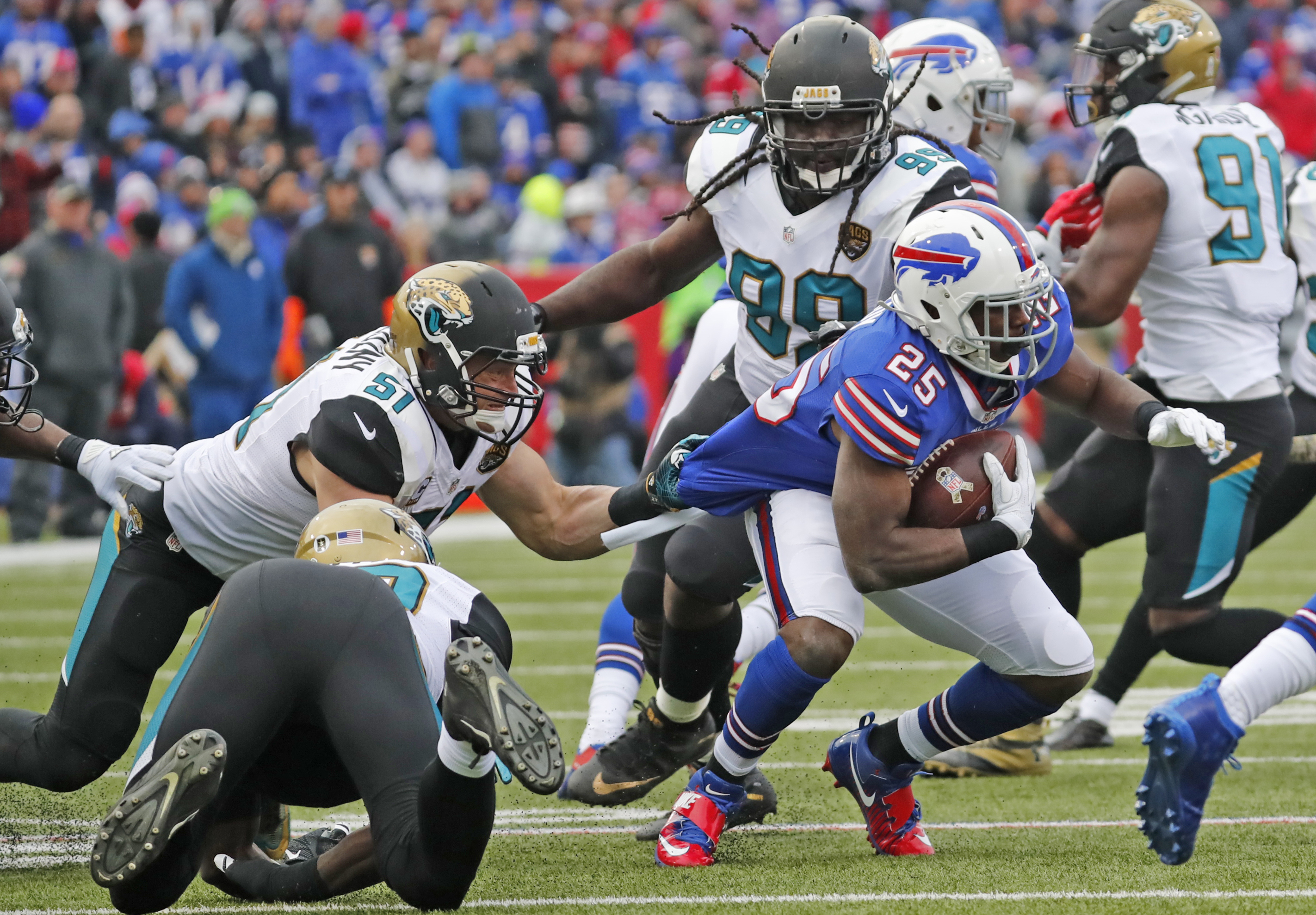 Buffalo Bills running back LeSean McCoy is tackled by the Jacksonville Jaguars' Paul Posluszny during the second quarter. (Harry Scull Jr./Buffalo News)