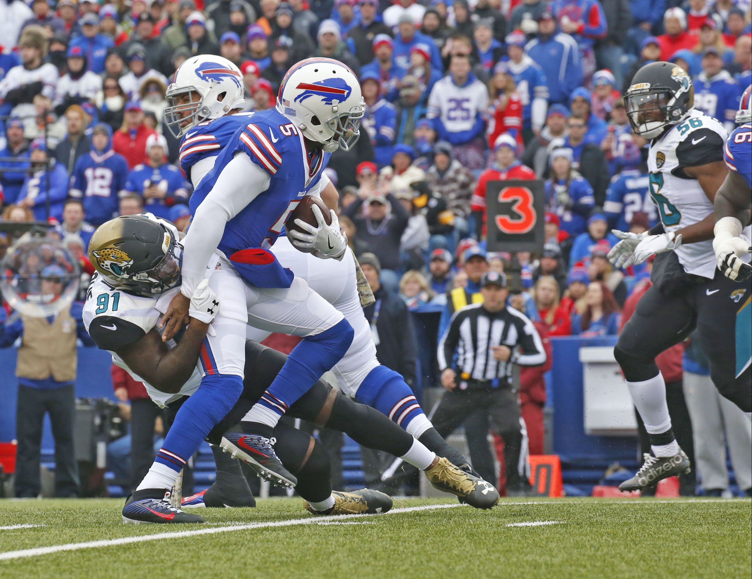 Jaguar Yannick Ngakoue sacks Tyrod Taylor in the first half. (Robert Kirkham/Buffalo News)