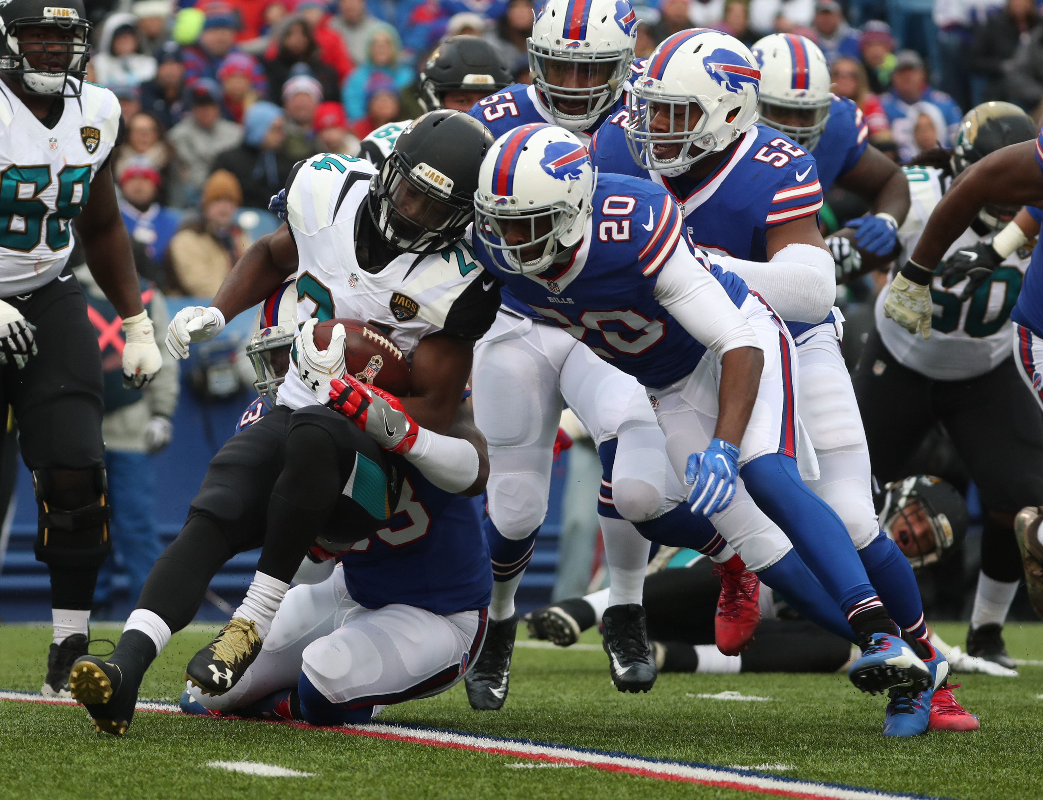 Buffalo Bills free safety Corey Graham (20) tackles Jacksonville Jaguars running back T.J. Yeldon (24) for a loss in the second quarter. (James P. McCoy/Buffalo News)
