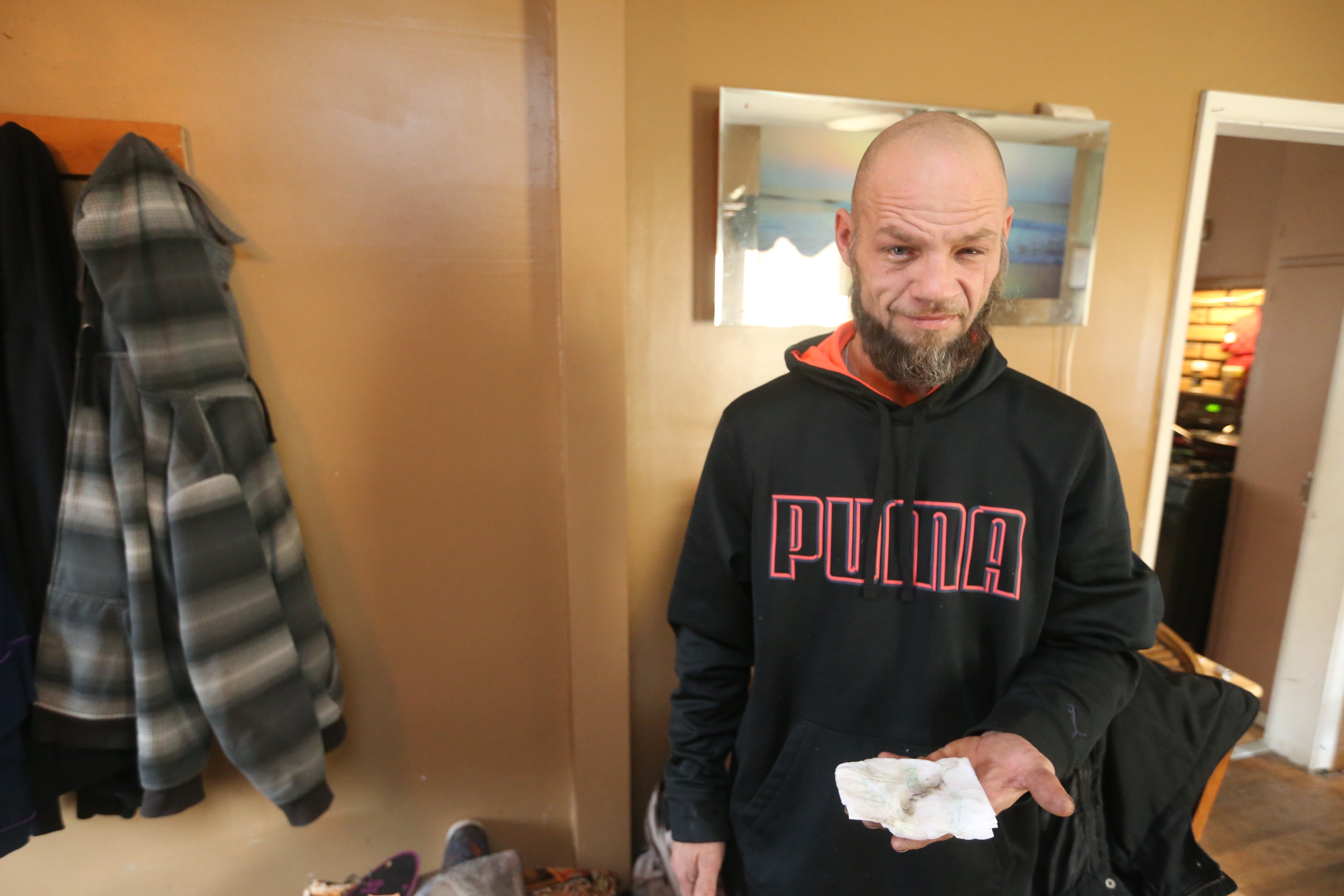 """Clarence """"Butch"""" Yeager from the Bethlehem Park neighborhood has been cleaning up for over a week inside his home and shows off what he just wiped from the walls, after a fire at the former Bethlehem Steel Plant , in Lackawanna, N.Y., on Wednesday, Nov. 23, 2016 he shows soot he has been wiping from walls in his home. (John Hickey/Buffalo News)"""