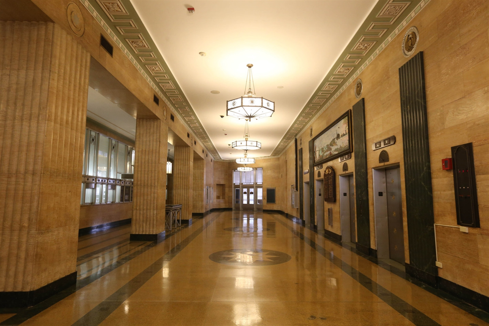 The main lobby of the Dillon Courthouse is composed of the original lobby, as well as the former post office lobby and the former financial lobby. These are linked visually on the first floor and distinguished from each other by ceiling height and columns.(Sharon Cantillon/Buffalo News)