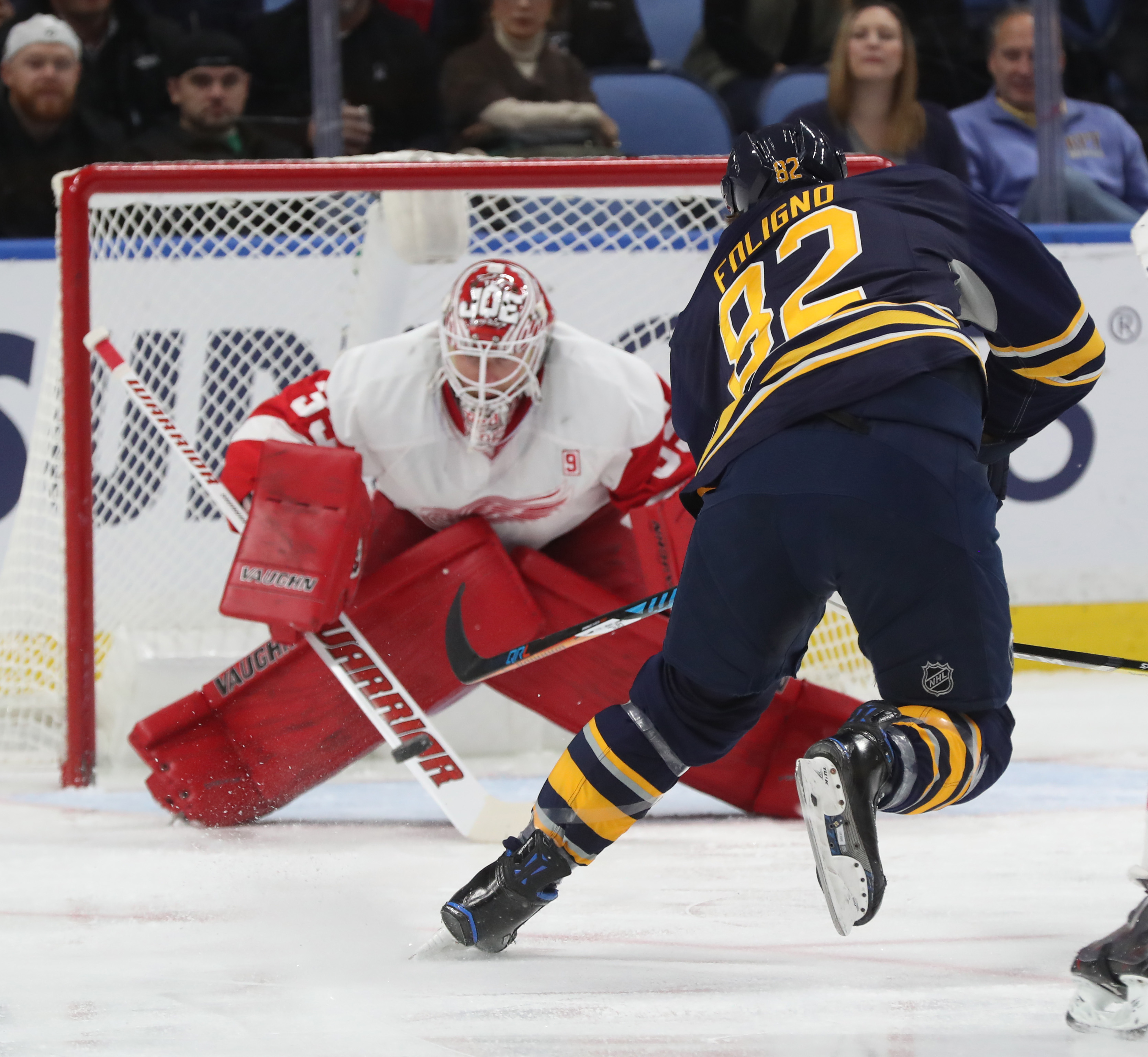 Marcus Foligno is stopped on a first-period breakaway by Detroit's Jimmy Howard  (James P. McCoy/Buffalo News)