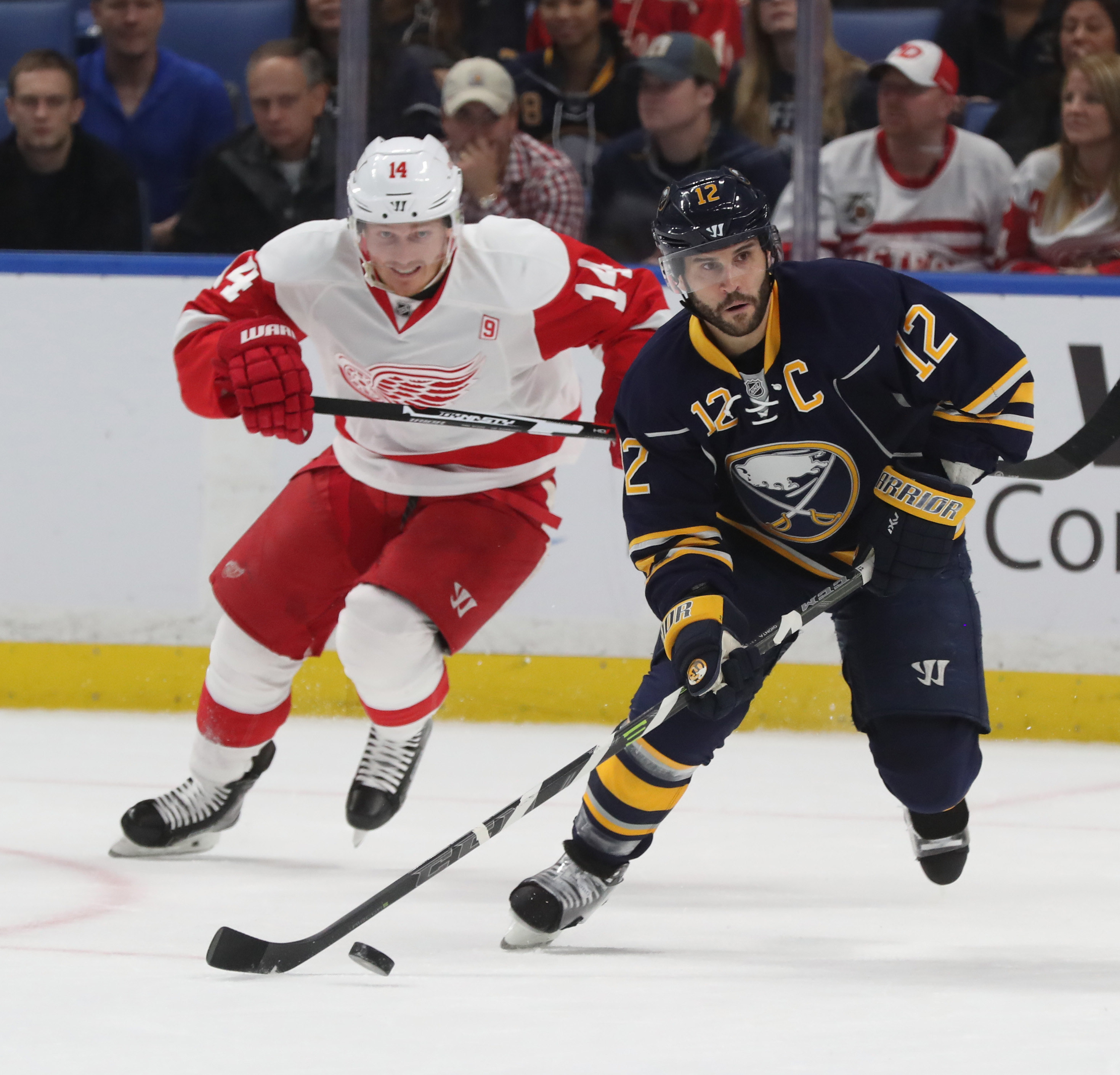 Brian Gionta (12) battles Detroit's Gustav Nyquist (14) for the puck during the first period (James P. McCoy/Buffalo News).