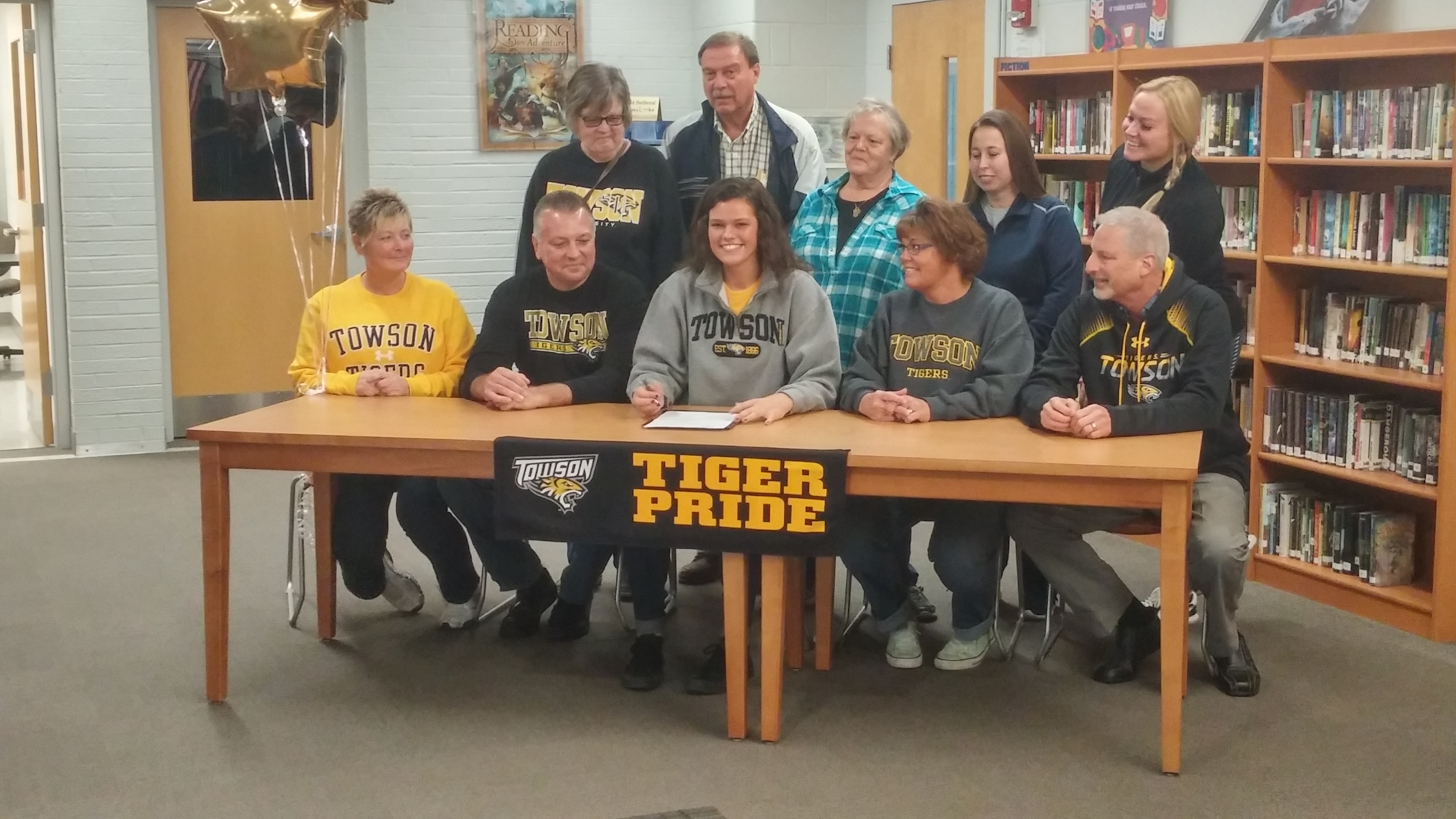 Tess Borgosz of Depew is surrounded by family after committing to Towson State.