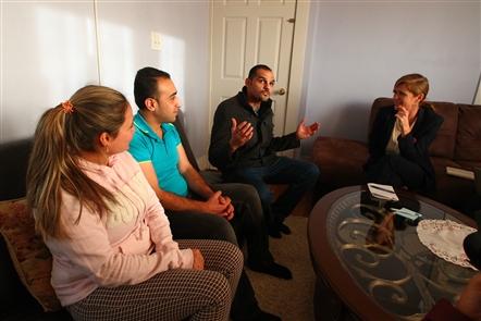Samantha Powers, right, U.S. Ambassador to the United Nations, toured  Buffalo's refugee community, meeting Syrian refugees Avin Rasho, left, her husband, Ayman Janno, as Iraqi  interpreter Hushan Salih translates  at Janno's Apartment,  in Buffalo on  Tuesday,  Nov. 22, 2016. (John Hickey/Buffalo News)
