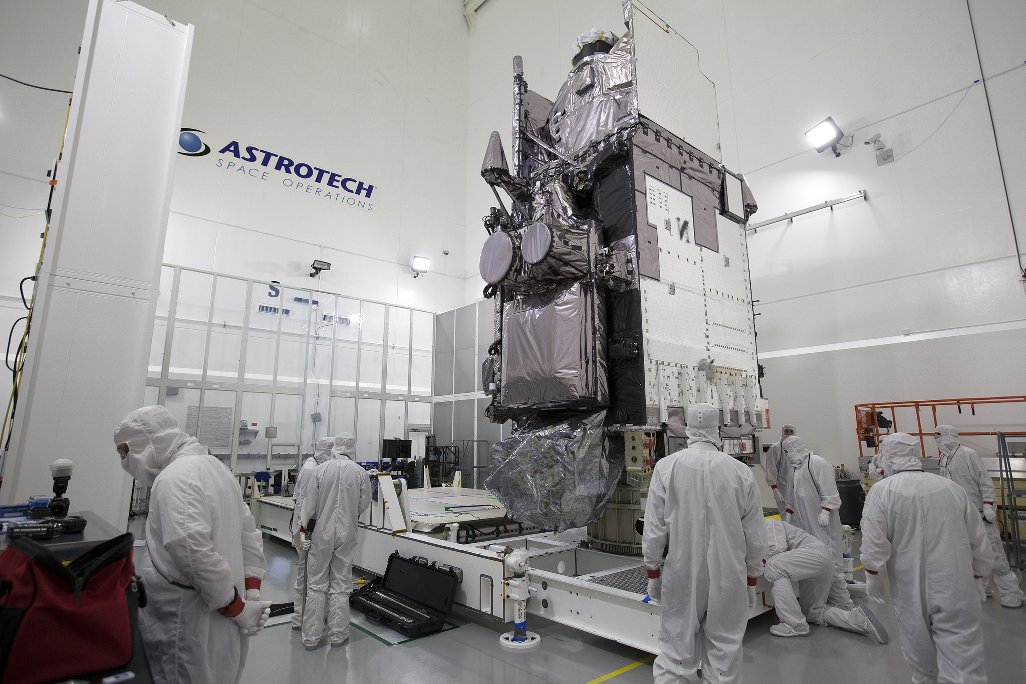 """Team members secure GOES-R in the vertical position on an """"up-ender"""" inside the Astrotech payload processing facility in Titusville, Fla., near NASA's Kennedy Space Center. GOES-R will be the first satellite in a series of next-generation NOAA GOES Satellites. (NASA/Charles Babir)"""
