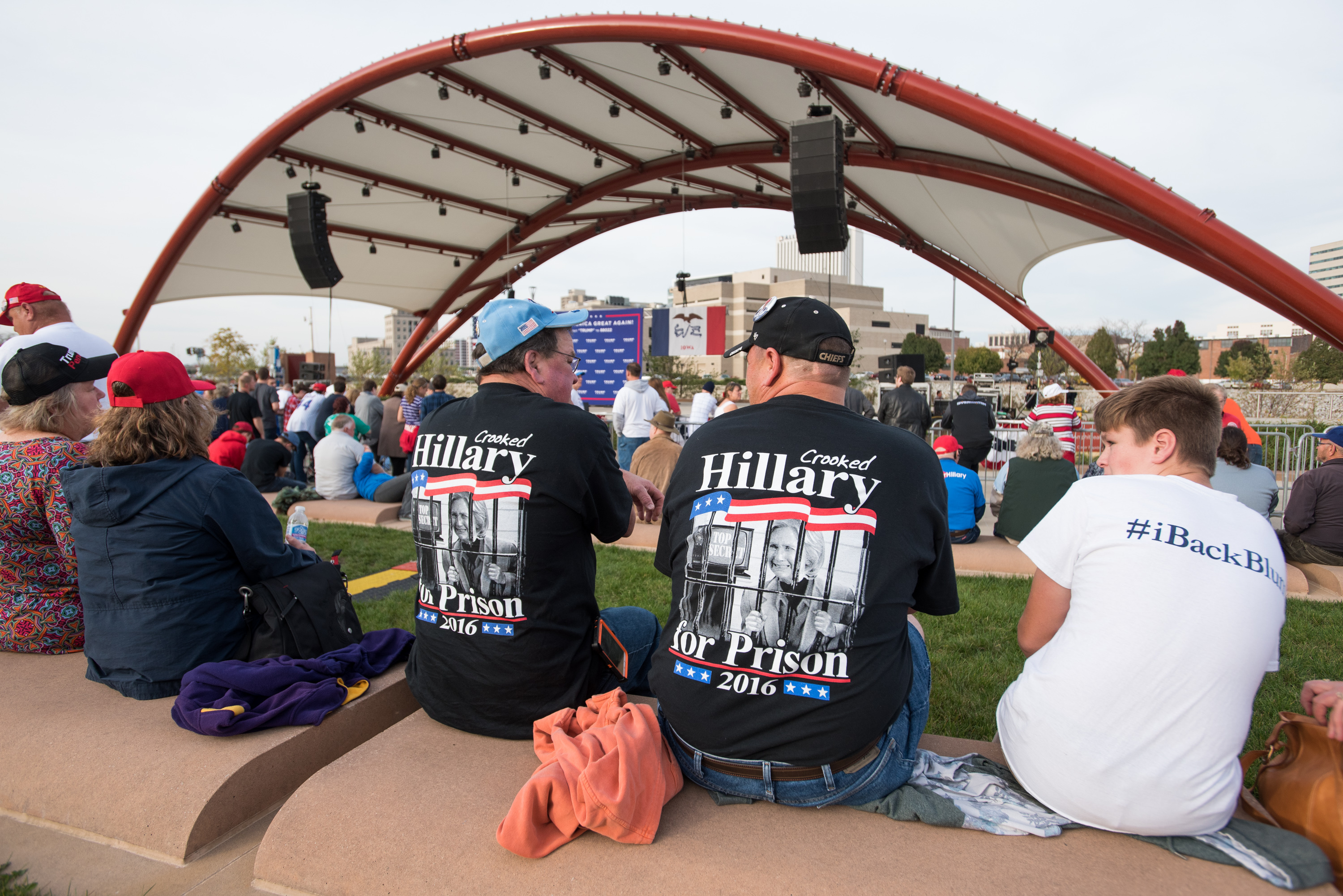 Supporters of then-Presidential candidate Donald J. Trump wait for him to speak at the McGrath Amphitheater on Oct. 28 in Cedar Rapids, Iowa. The crowd of a few thousand warmed up by chanting 'Lock her up' and waving signs of Women for Trump. (David Greedy/Getty Images)