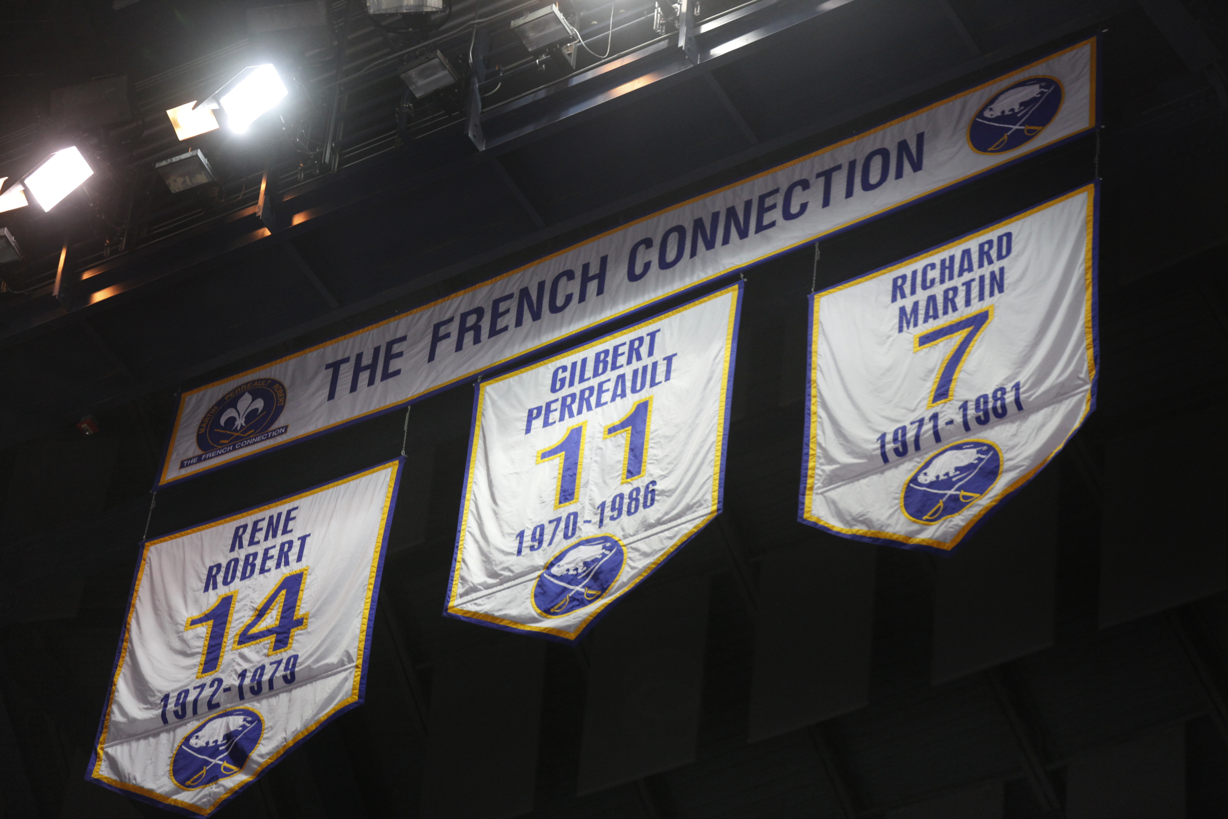 The French Connection's retired numbers hang from the rafters at KeyBank Center. (Harry Scull Jr./Buffalo News)