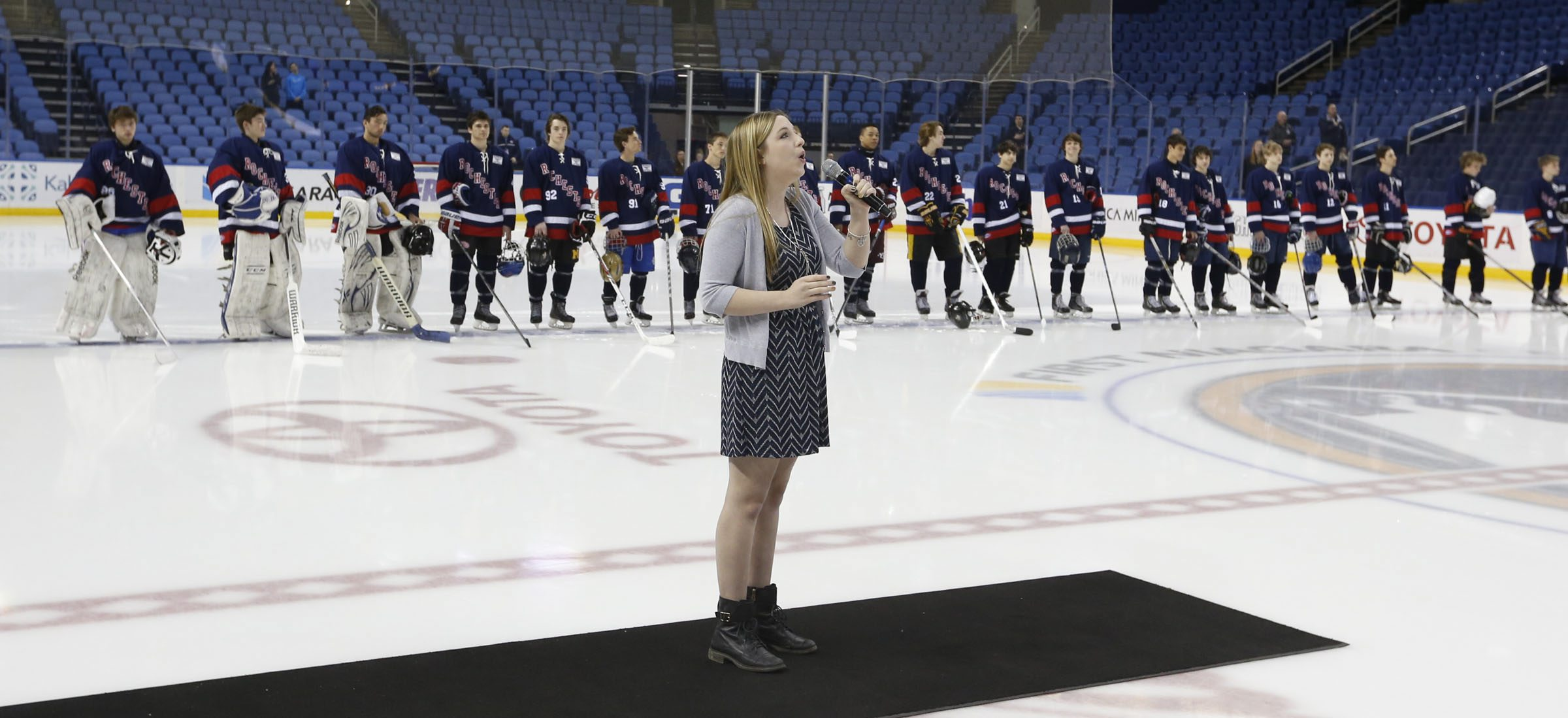 Anna Heerdt, shown here singing the national anthems prior to Buffalo and Rochester junior's game for the Bowman Cup at the First Niagara Center in April 2015, is scheduled to sing before the Buffalo Bills game Sunday. (Harry Scull Jr./Buffalo News)