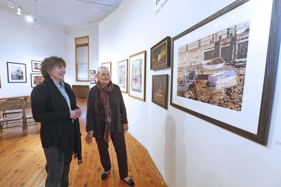 Jennifer Kursten, program coordinator at Carnegie Art Museum, left, with watercolor artist E. Jane Stoddard of East Amherst, at the center on Saturday, Nov. 19, 2016. (Robert Kirkham/Buffalo News)