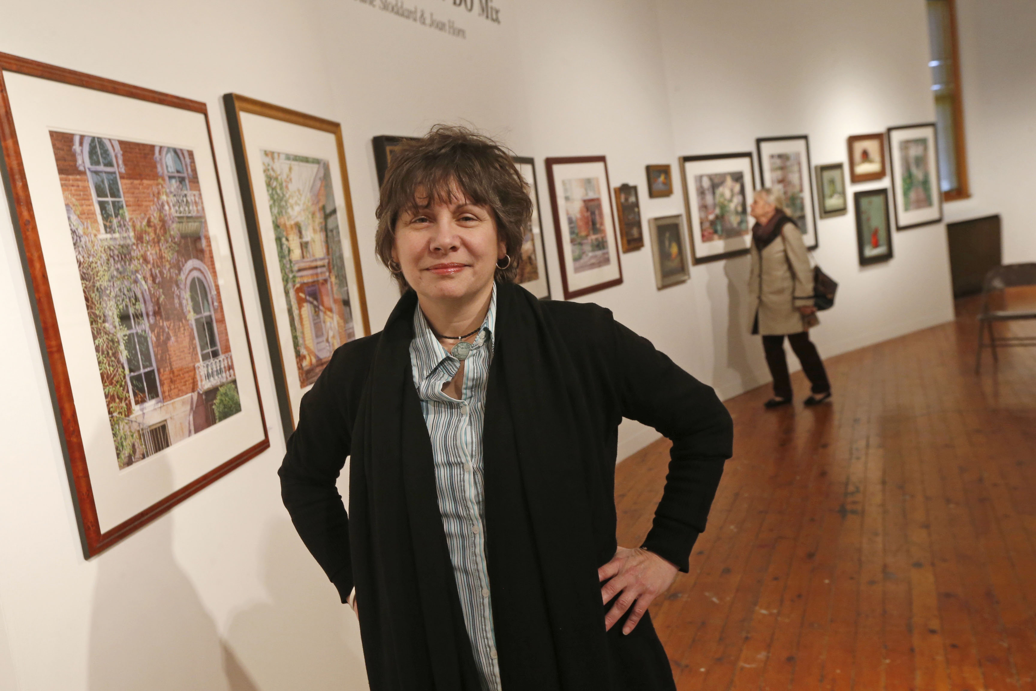 "Jennifer Kursten, program coordinator at Carnegie Art Center, is preparing for the center's ""Art off the Wall"" fundraiser on Thursday, Dec. 3, 2016. She was photographed Nov. 19 in the center.  (Robert Kirkham/Buffalo News)"