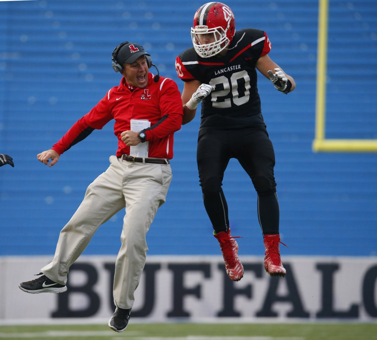Defensive coordinator Dave Mansell and linebacker Ben Damiani celebrate after a defensive stand during Lancaster's 27-7 victory over Orchard Park in the Section VI Class AA final. (Harry Scull Jr./Buffalo News)