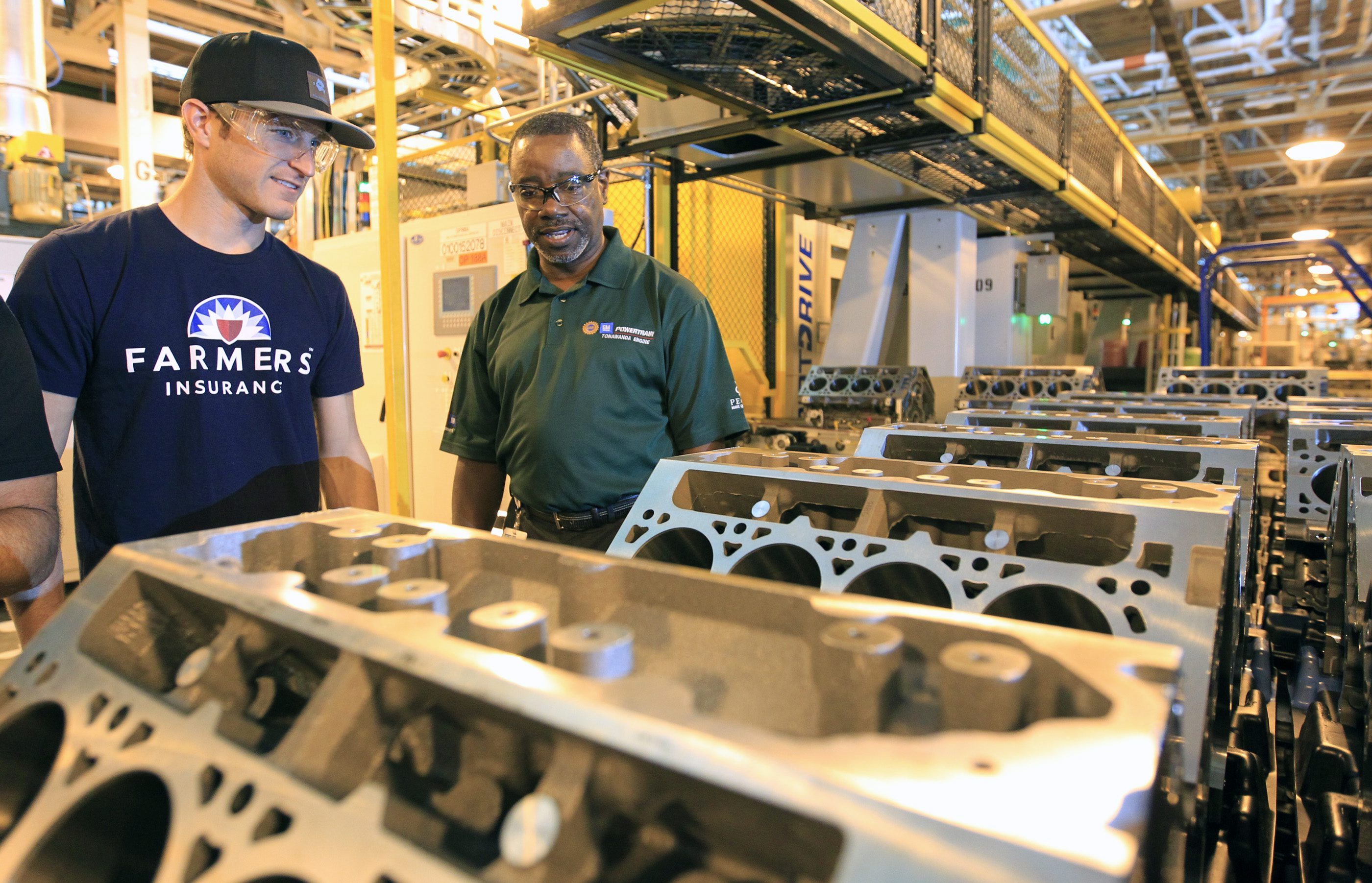 Tonawanda Engine Plant Manager Steve Finch, right, says humans have to install, program and maintain the robots, so 'it doesn't mean that because I've put a robot in there that I've gotten rid of all the jobs.' (News file photo)