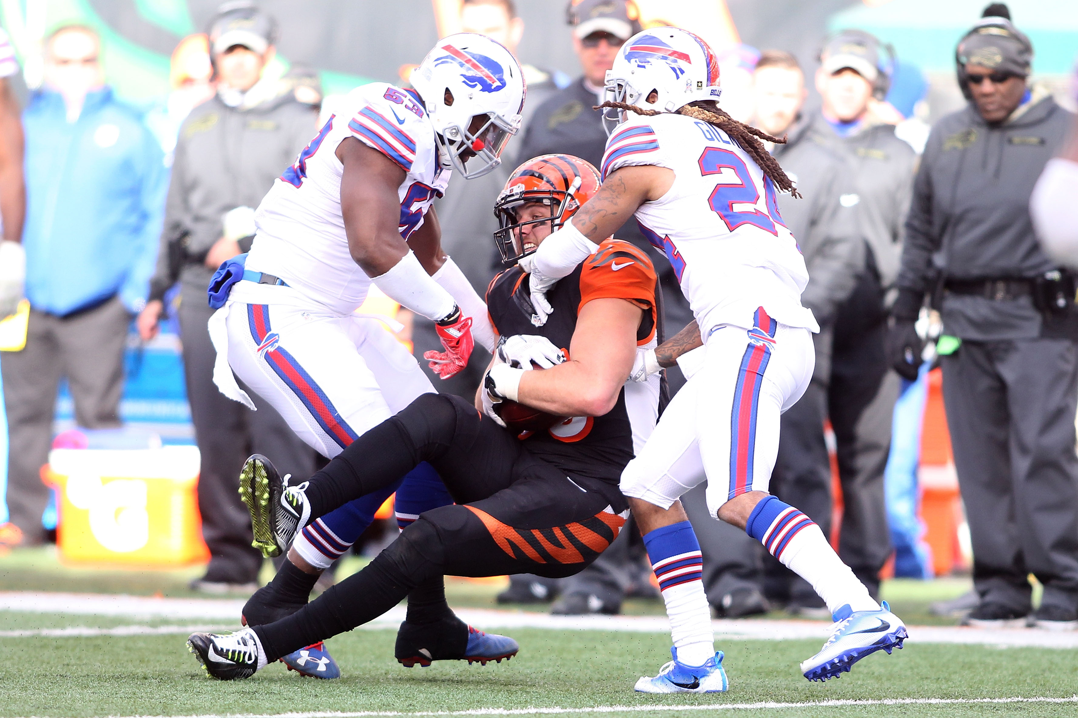 Tyler Eifert of the Cincinnati Bengals is tackled by Stephon Gilmore and Zach Brown (53) during the second quarter. (Getty Images)