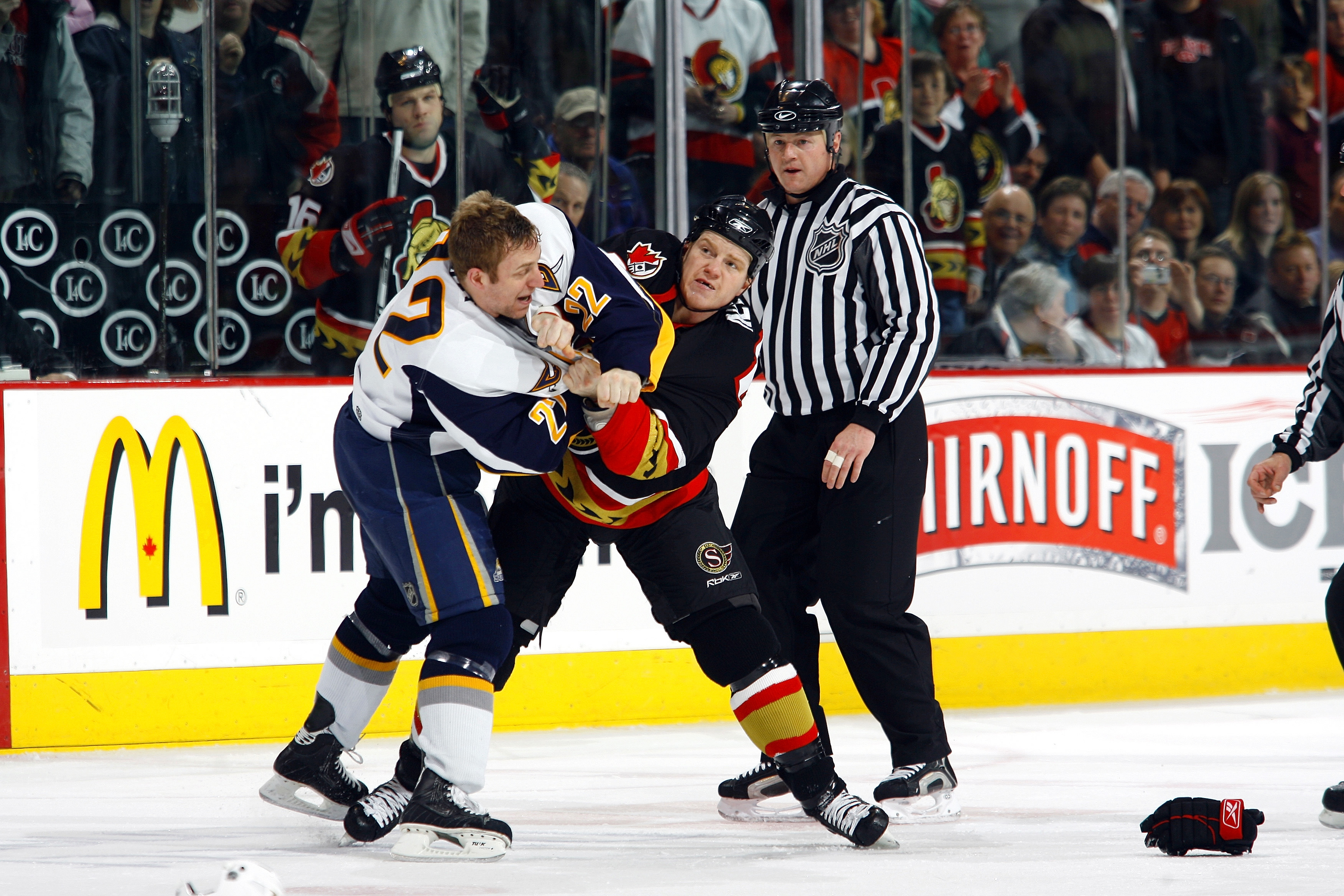 Chris Neil has been battling the Sabres for 15 seasons, including this 2007 fight with Adam Mair. (Getty Images)