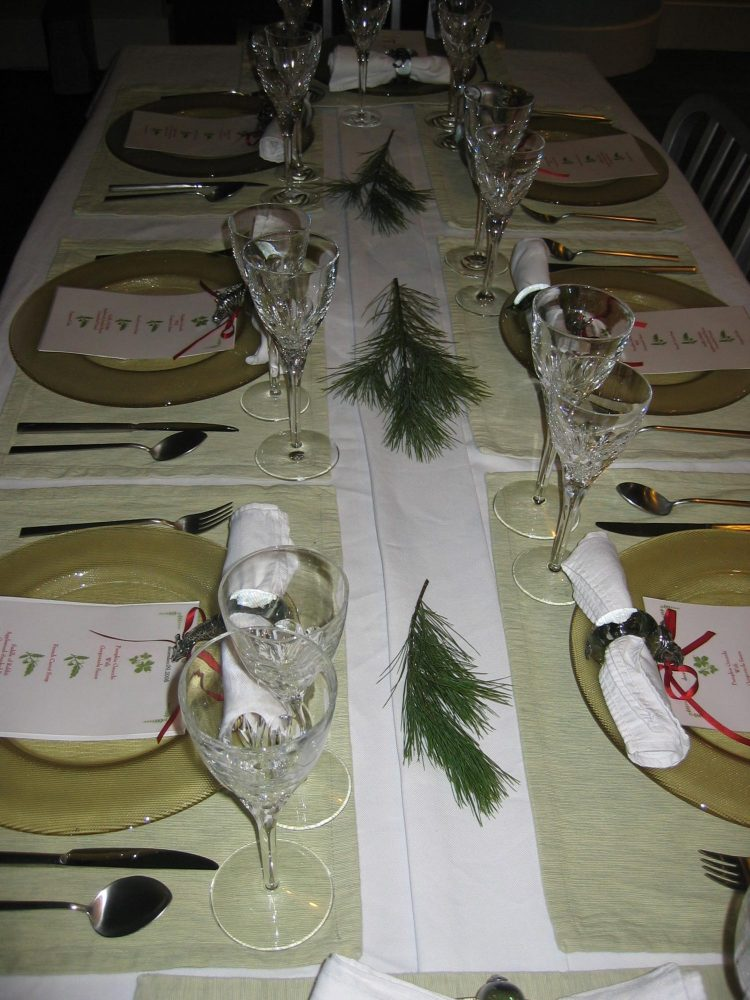 Small branches cut from a pine tree acts as a centerpiece along a holiday table. (Handout/TNS)