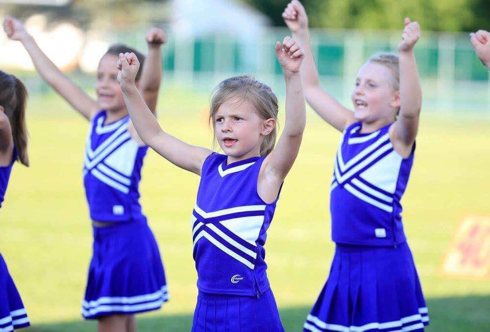 7-year-old Alyssa Hearn, middle, was struck by a school bus on Friday. Alyssa was a cheerleader for the Springville peewee team. (Harry Scull Jr. for The Buffalo News)