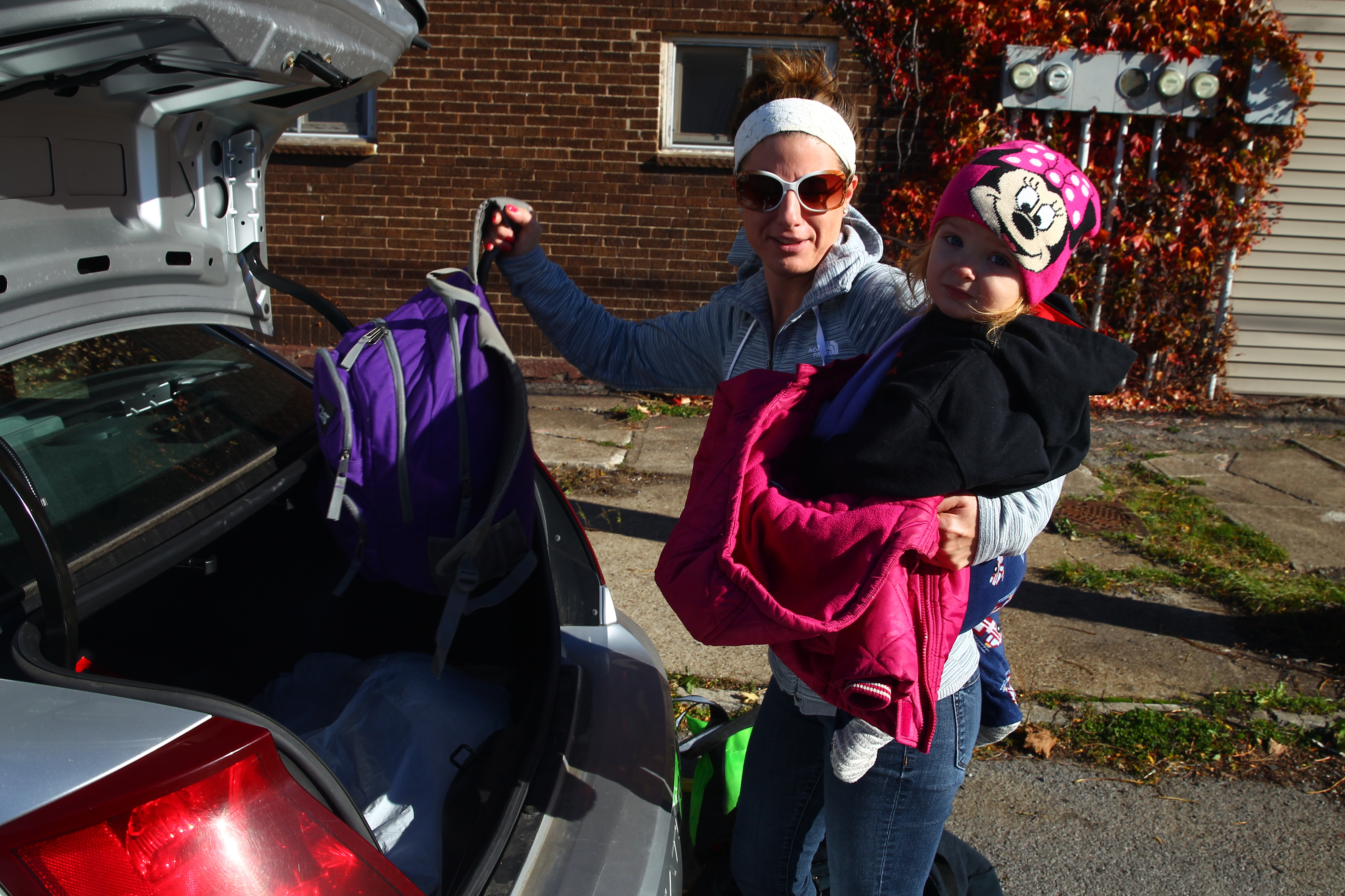 Rebecca and her niece, Autumn, 2, pack up after a mandatory evacuation for residents at Bethlehem Park neighborhood on Thursday, Nov. 10, 2016, as the wreckage from the nearby former Bethlehem Steel site still smoldered. (John Hickey/Buffalo News)