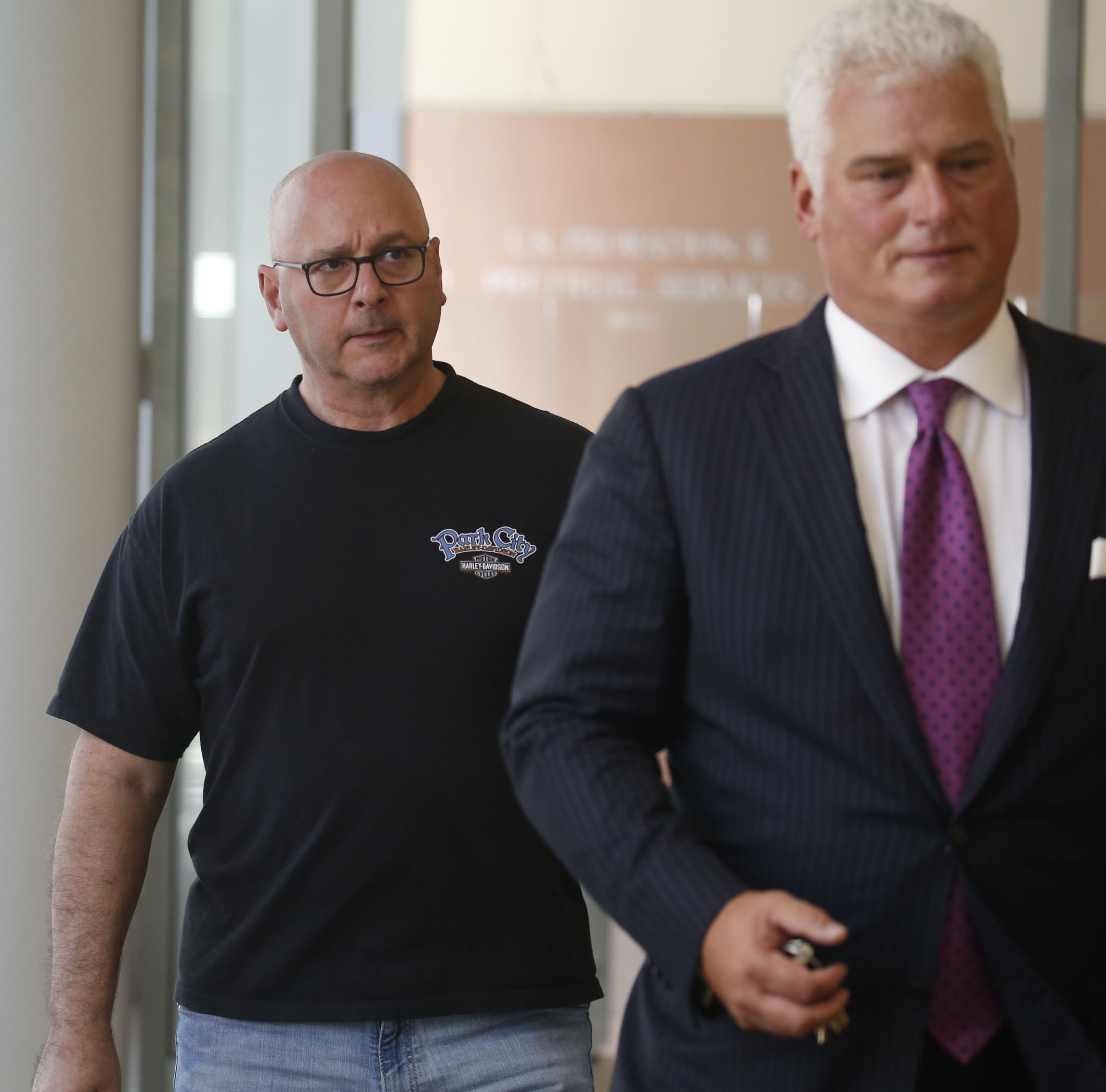 Louis P. Ciminelli, left, gets escorted out of court with his attorney Daniel C. Oliverio after being arraigned on charges of conspiracy to commit wire fraud, wire fraud and bribery at Buffalo federal court in 2016. The bribery charge has since been dropped. (News file photo)