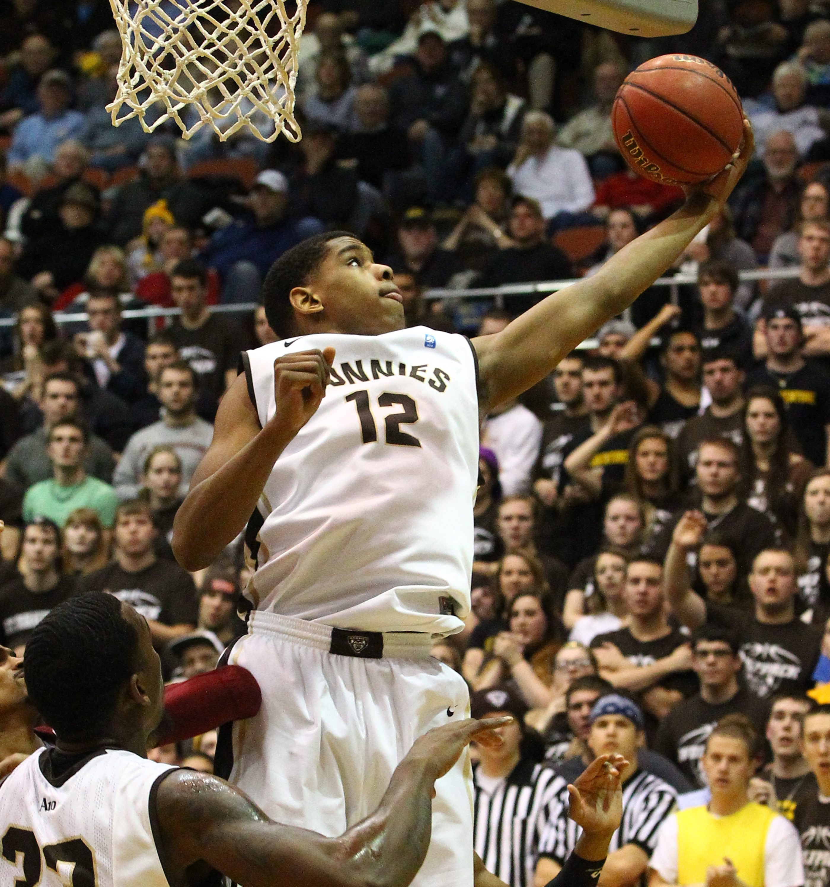 St. Bonaventure Bonnies guard/forward Denzel Gregg (12) scores two points over Massachusetts Minutemen forward Raphiael Putney (34) in the first half at the Reilly Center at St Bonaventure in Olean,NY on Wednesday, Jan. 29, 2014. (James P. McCoy/ Buffalo News)